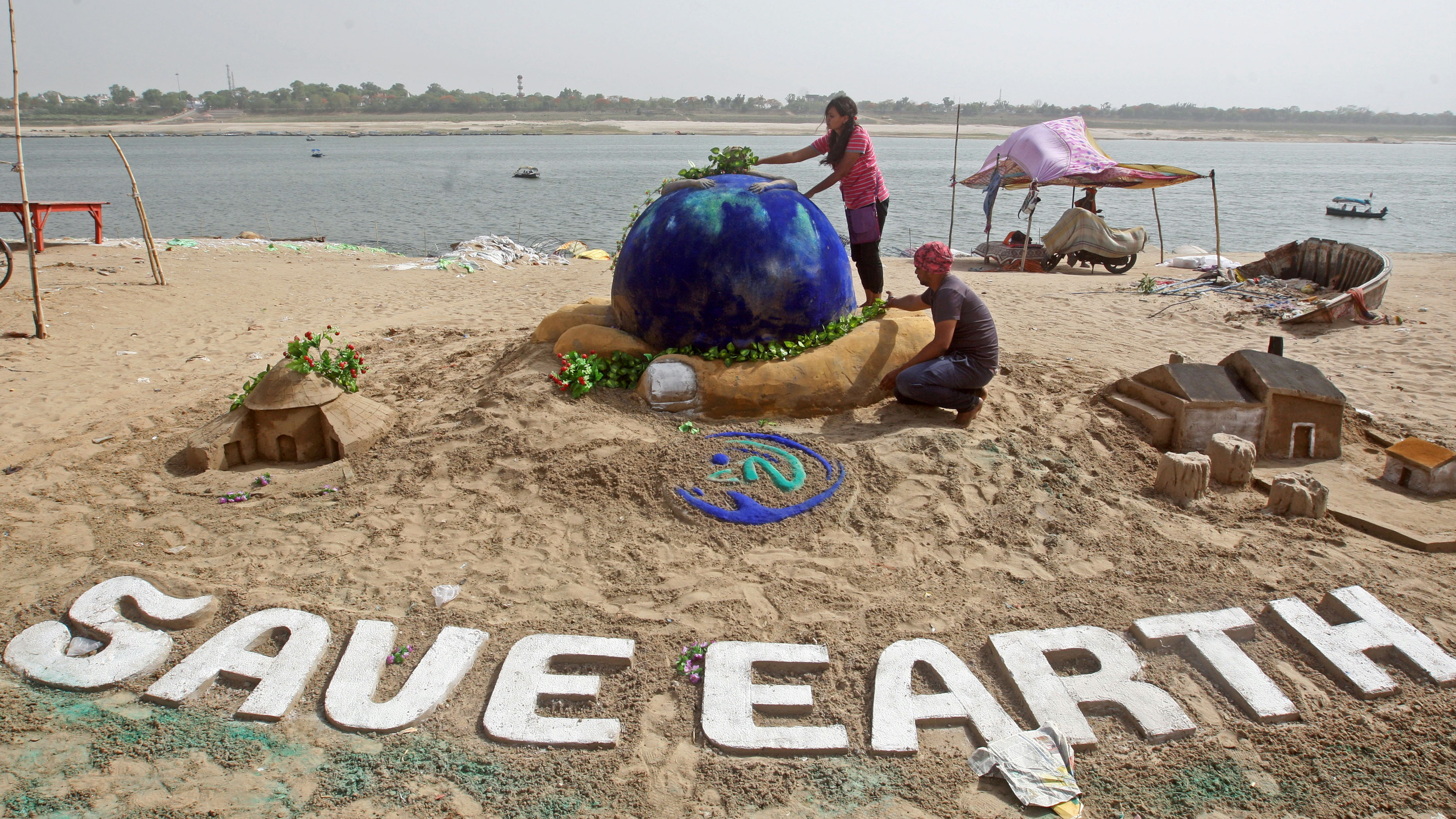 children on a beach on earth day