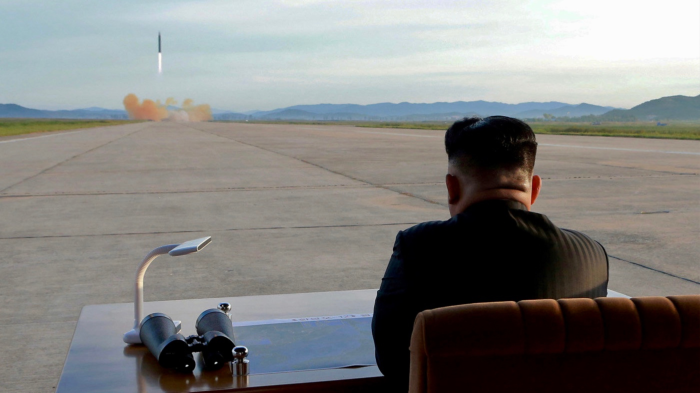 North Korean leader Kim Jong-un watches the launch of a Hwasong-12 missile in this undated photo released on September 16, 2017 by the Korean Central News Agency.