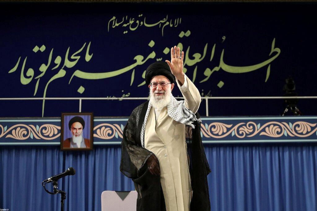 Ayatollah Khamenei stands on a stage.