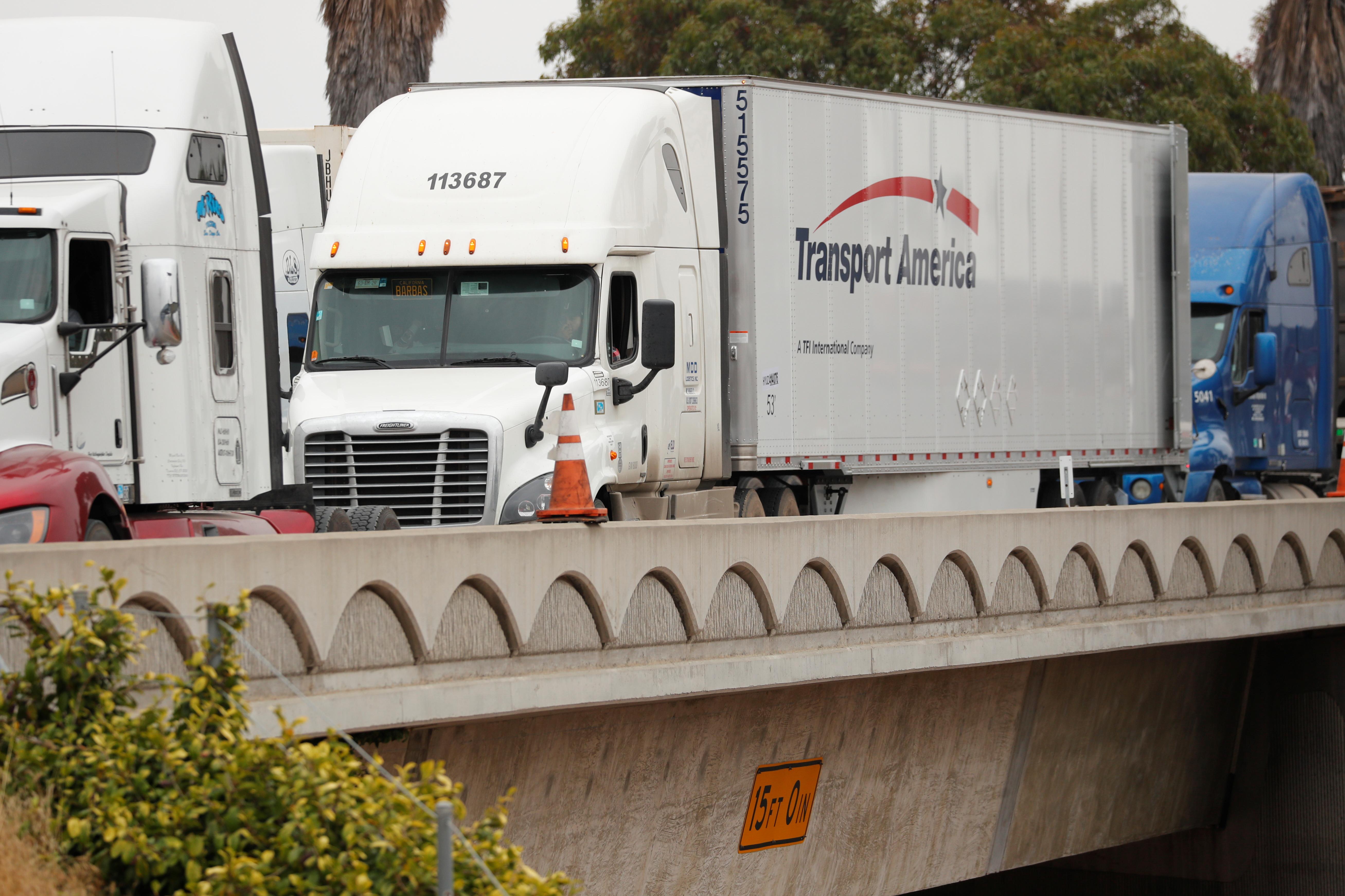 A truck crosses a bridge on the US-Mexican border.