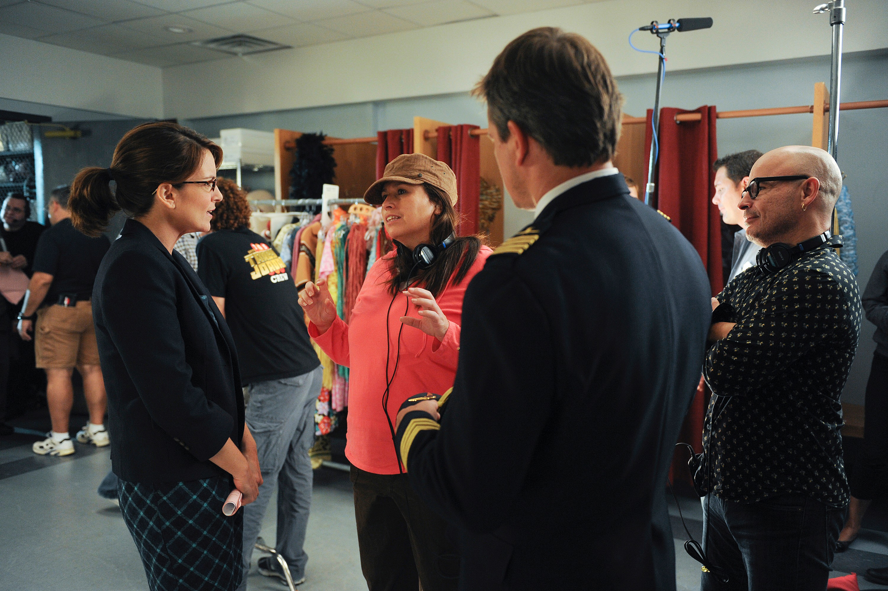 """Beth McCarthy-Miller (center) on the set of """"30 Rock"""" with Tina Fey (left) and guest star Matt Damon (right)."""