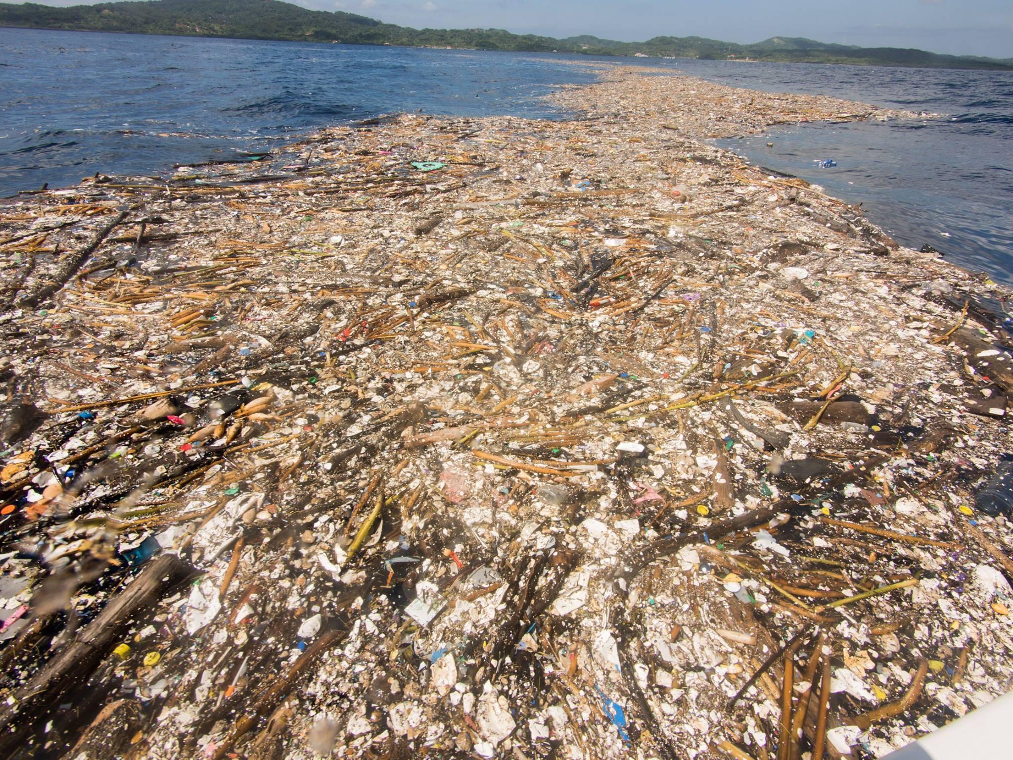 Plastic waste floats off the coast of Roatan, Honduras on September 7, 2017.