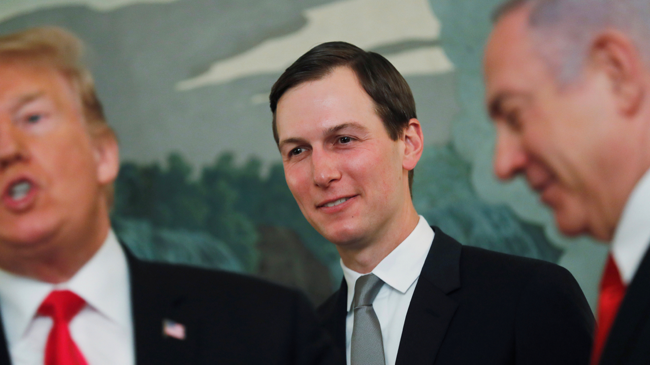 White House senior advisor Jared Kushner smiles while listening to US President Donald Trump talk as the president meets with Israel's Prime Minister Benjamin Netanyahu at the White House in Washington, U.S., March 25, 2019.