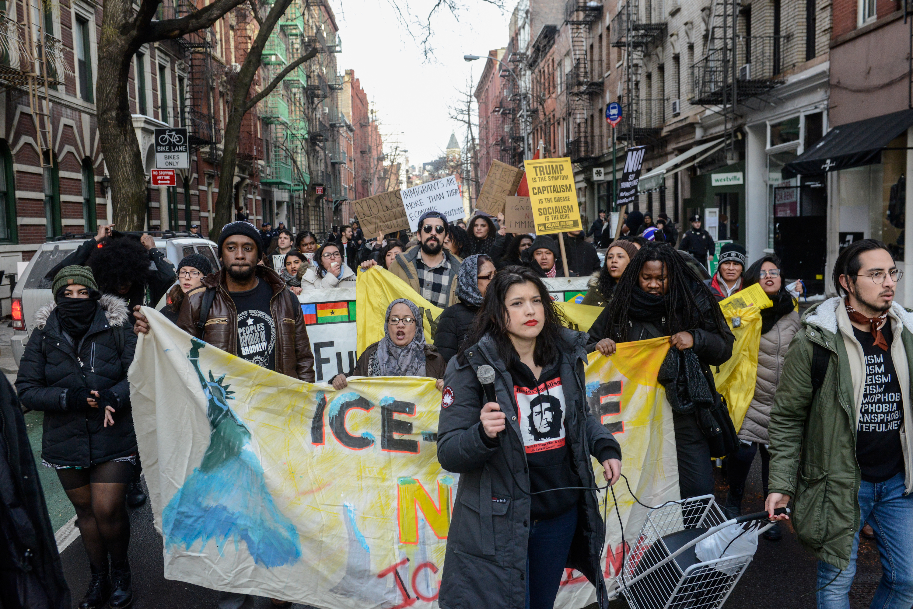 People participate in a protest against U.S. President Donald Trump's immigration policy and the recent Immigration and Customs Enforcement (ICE) raids in New York City, U.S. February 11, 2017.
