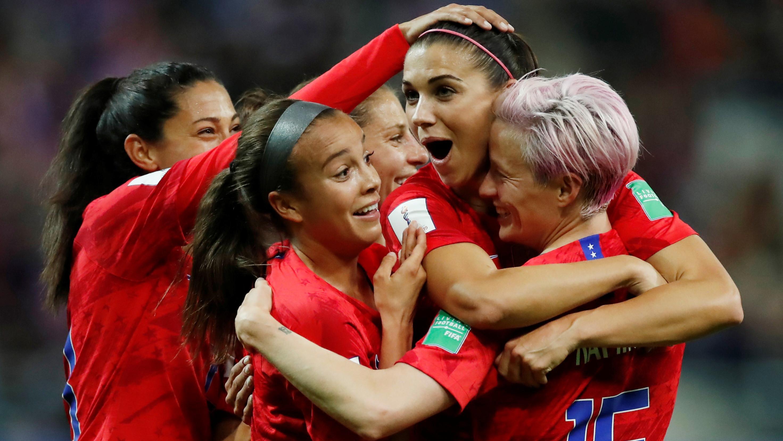 Alex Morgan of the US celebrates scoring their twelfth goal with Megan Rapinoe and teammates.