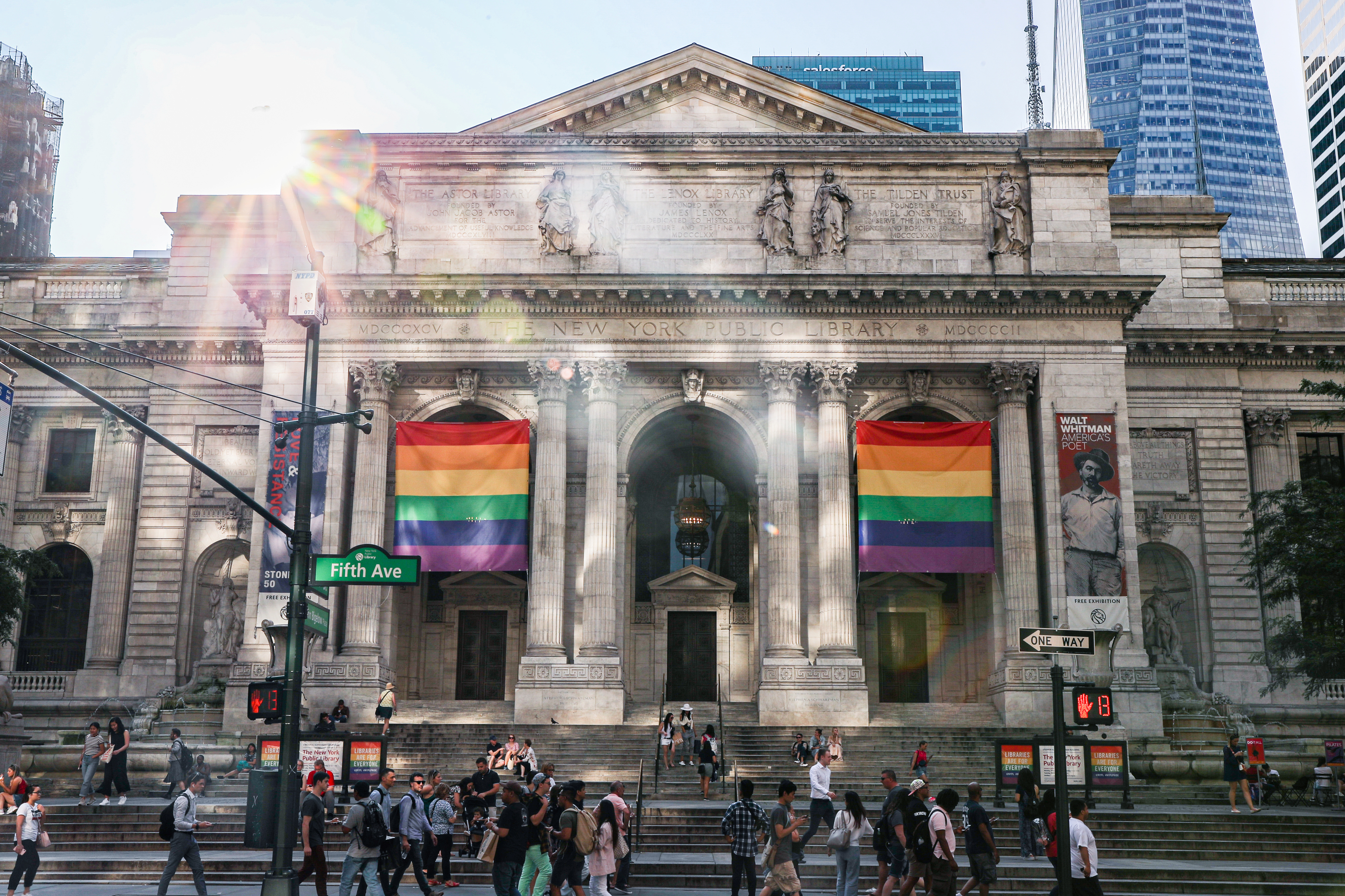 Pride flags are hung in front of the New York Public Library.