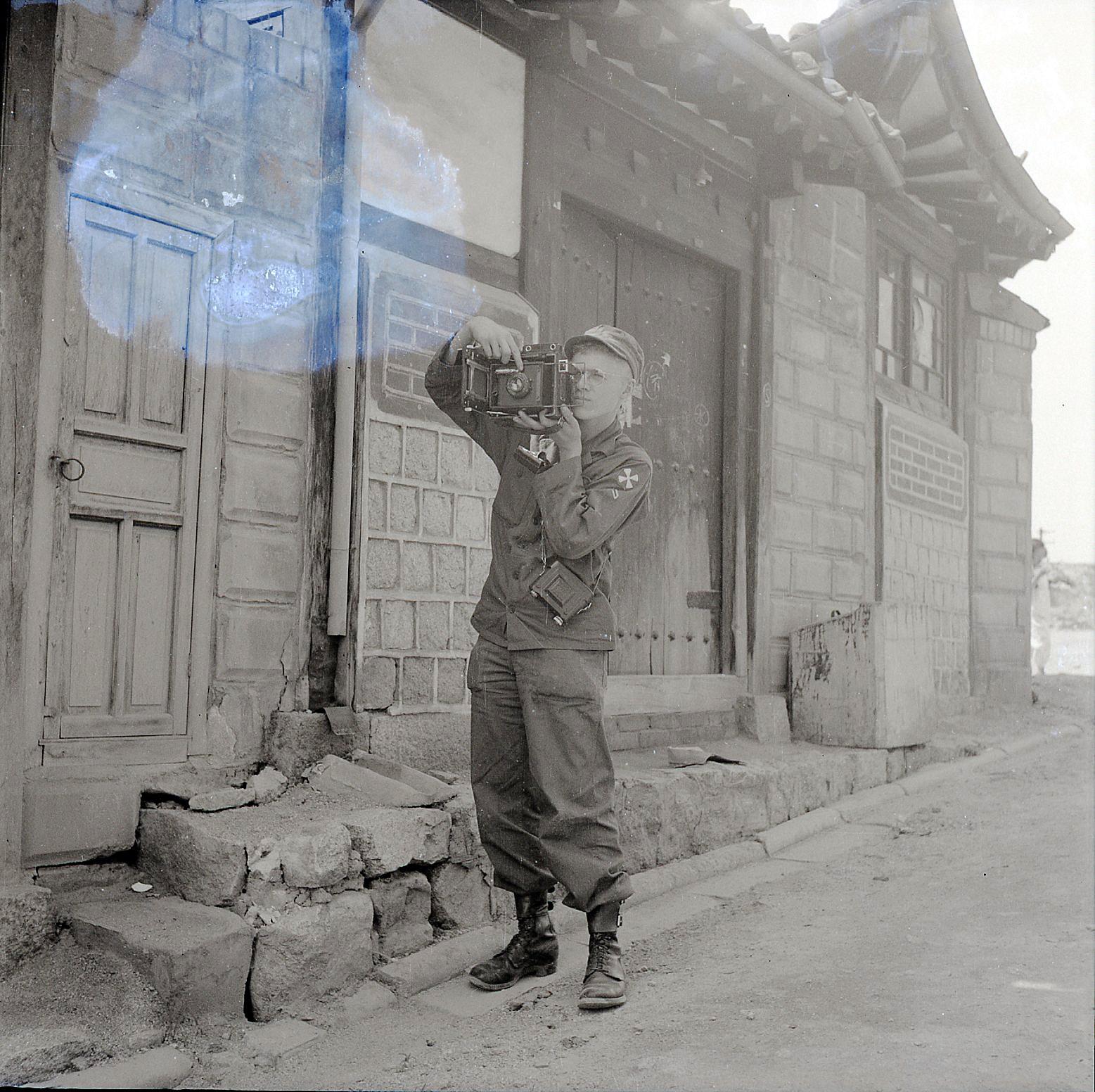 allan manuel takes a photo in korea