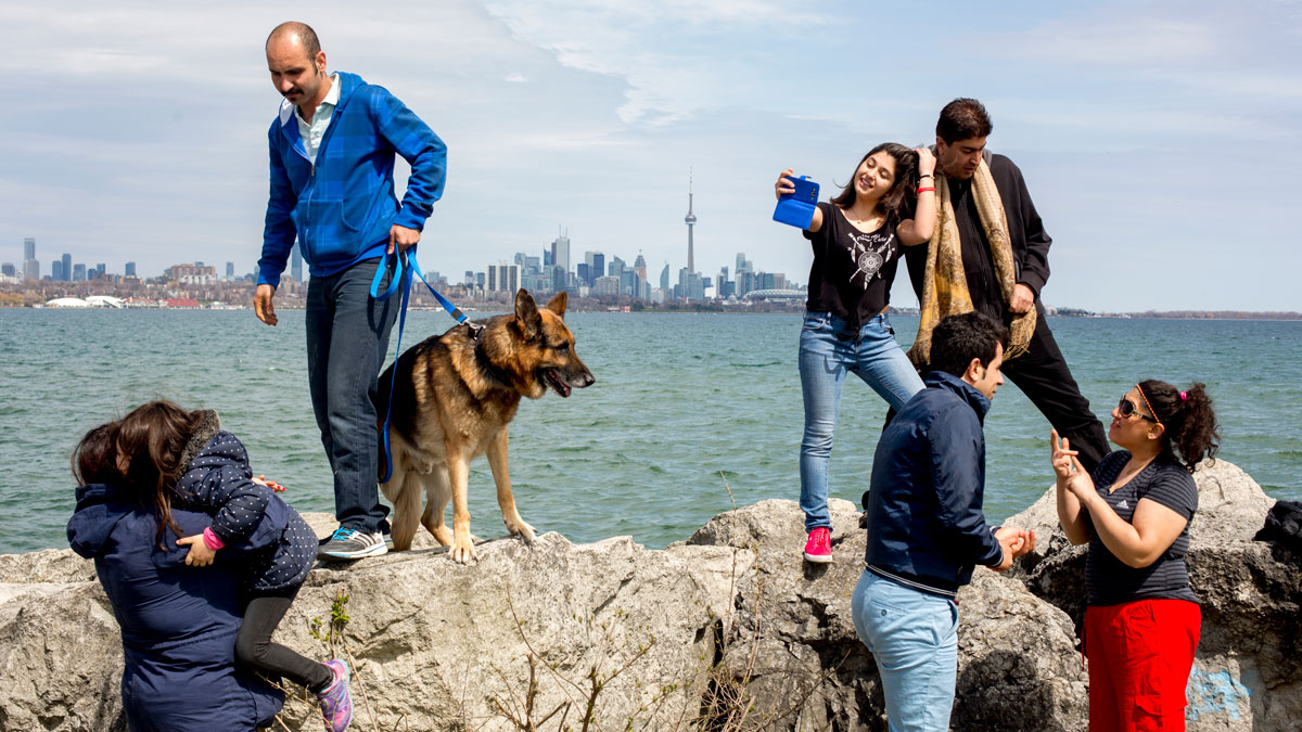 Iranian refugee families enjoy a Sunday picnic at Toronto Humber Bay Park.