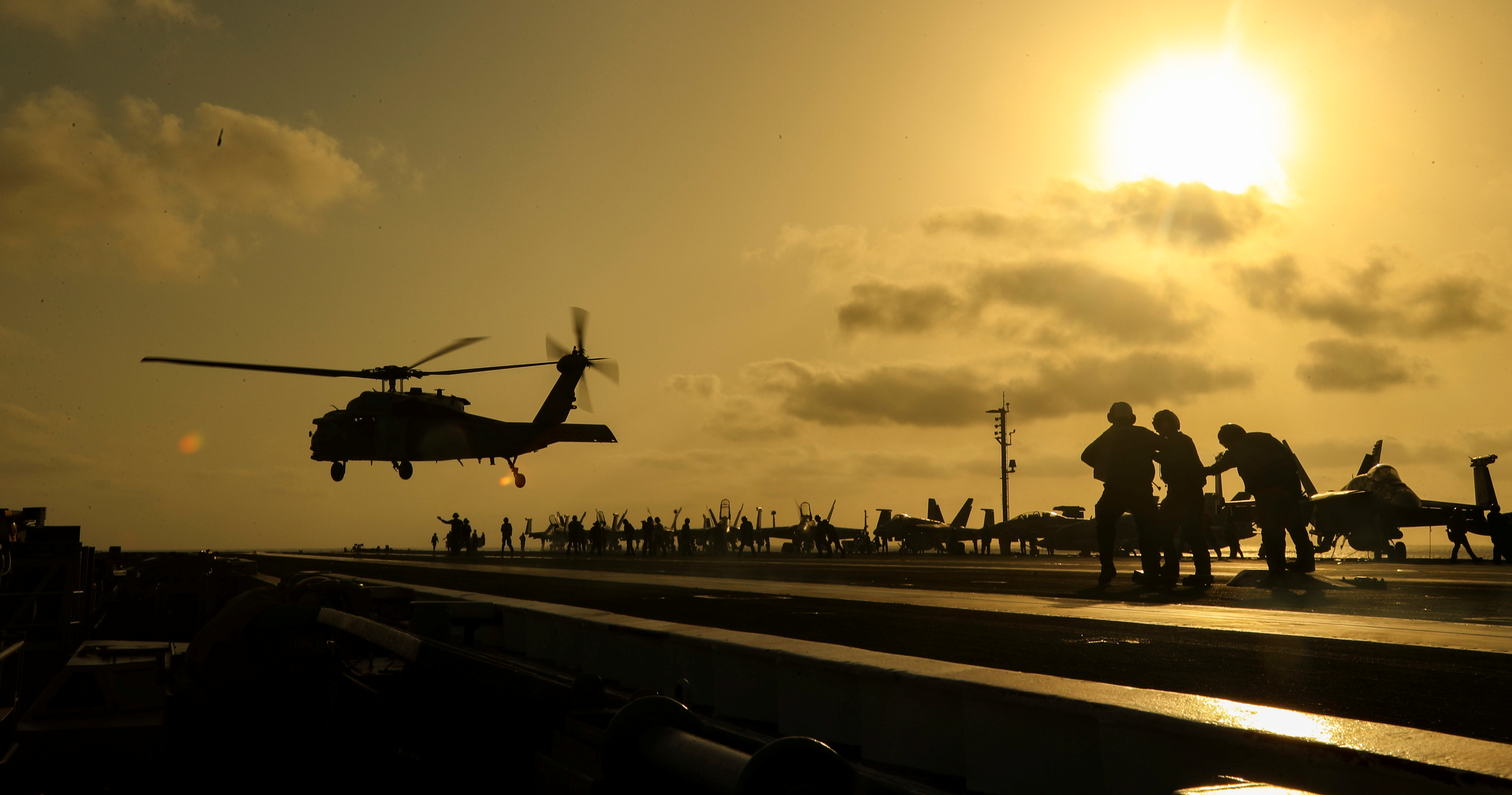 An MH-60S Seahawk helicopter lifts off the flight deck of the USNavy aircraft carrier USS Abraham Lincolnin the Arabian Sea, June 3, 2019.