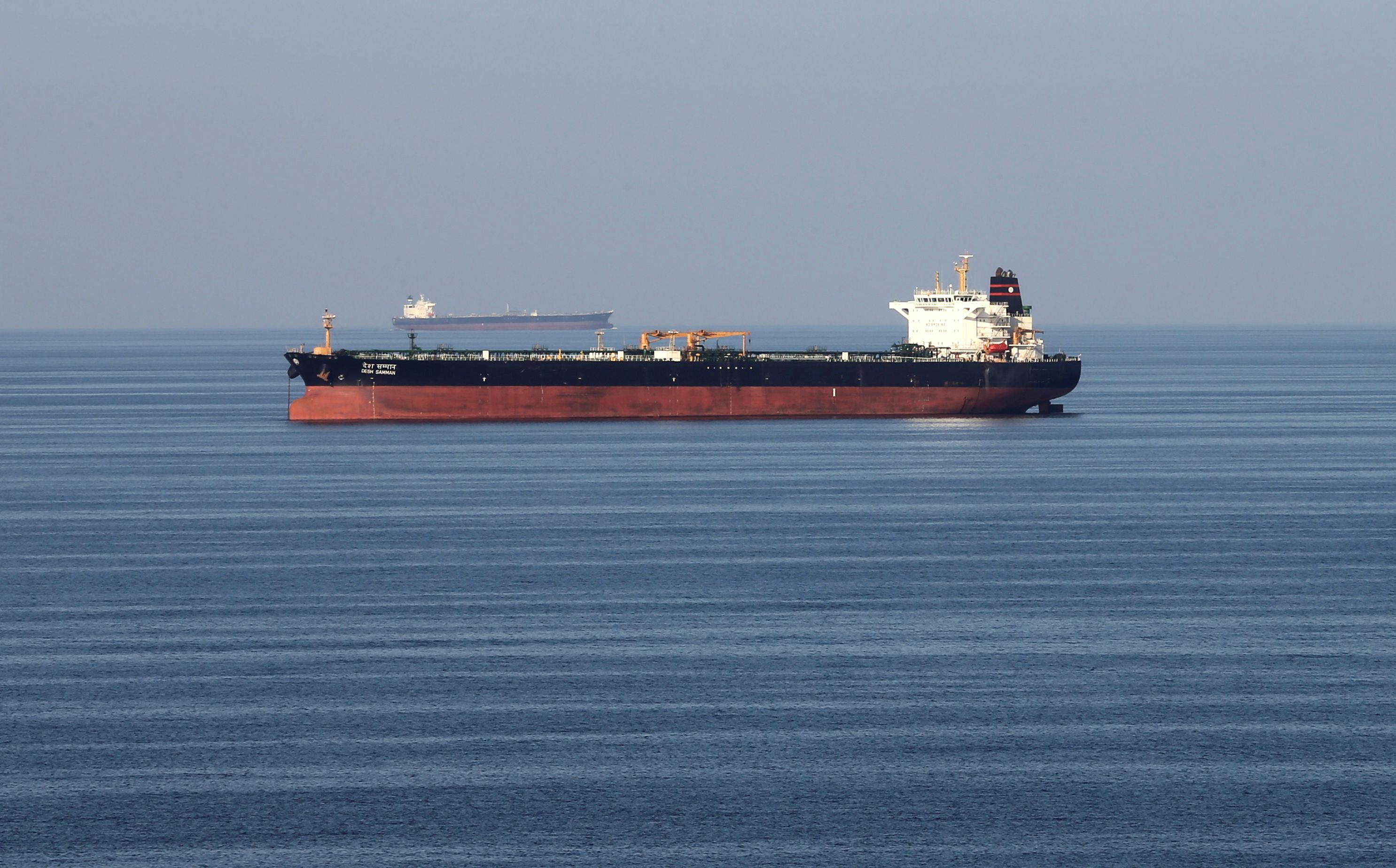 Two oil tankers in the ocean.