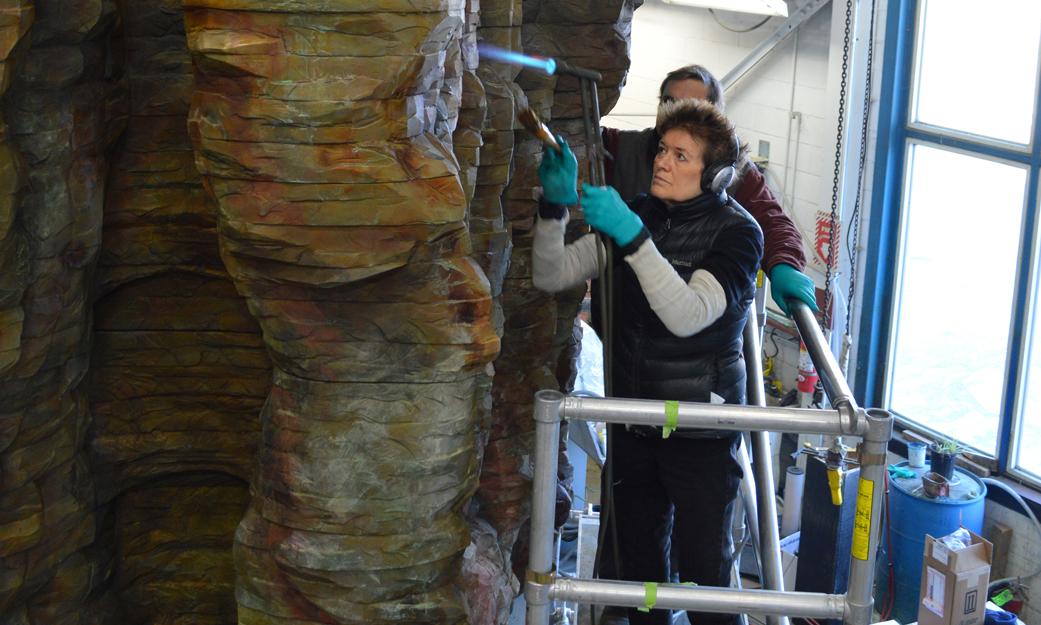 "Ursula von Rydingsvard climbs a ladder to work on her sculpture ""Bronze Bowl with Lace,"" 2013."