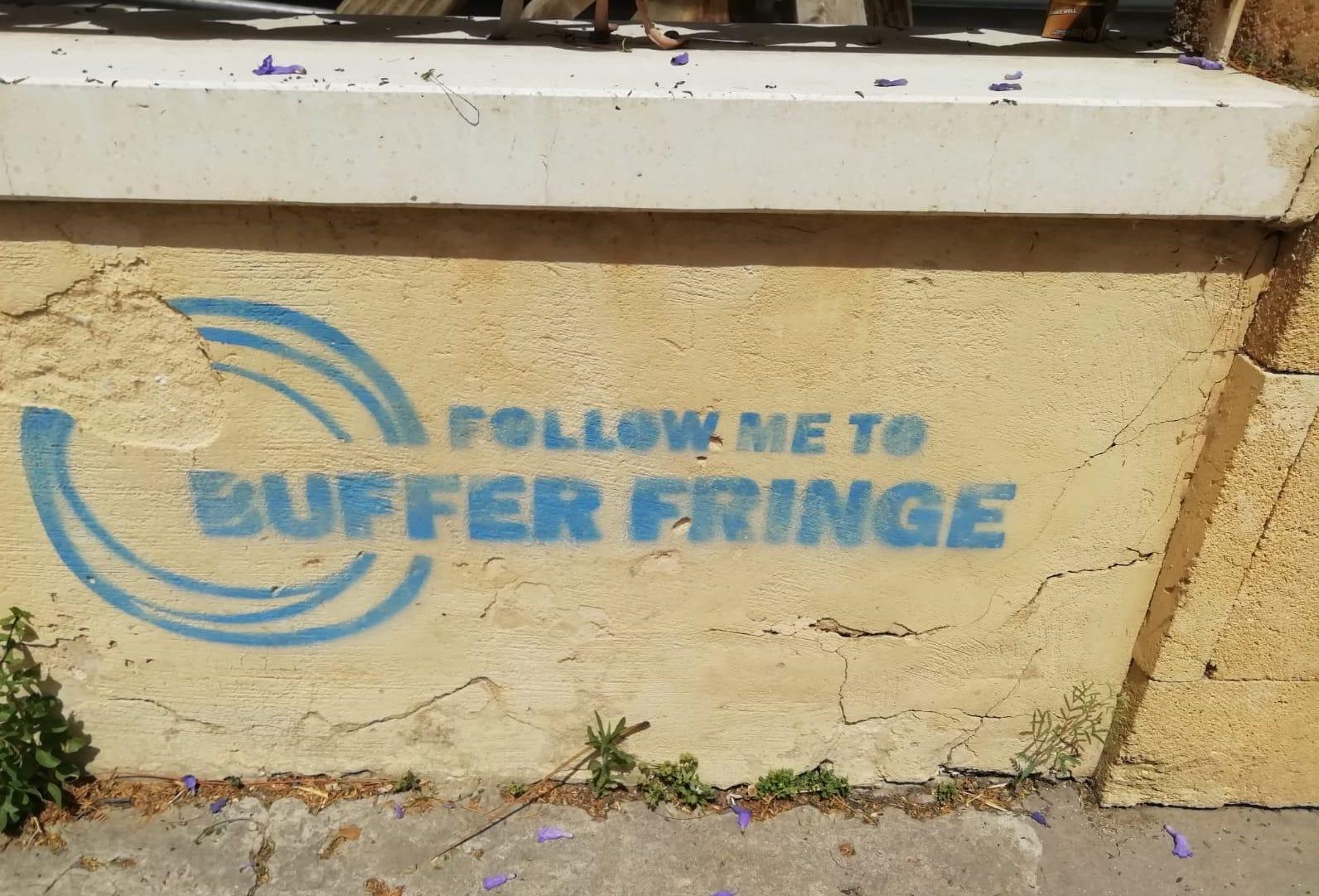 "Graffiti seen on wall in Nicosia in blue lettering reads ""Follow Me to Buffer Fringe"""