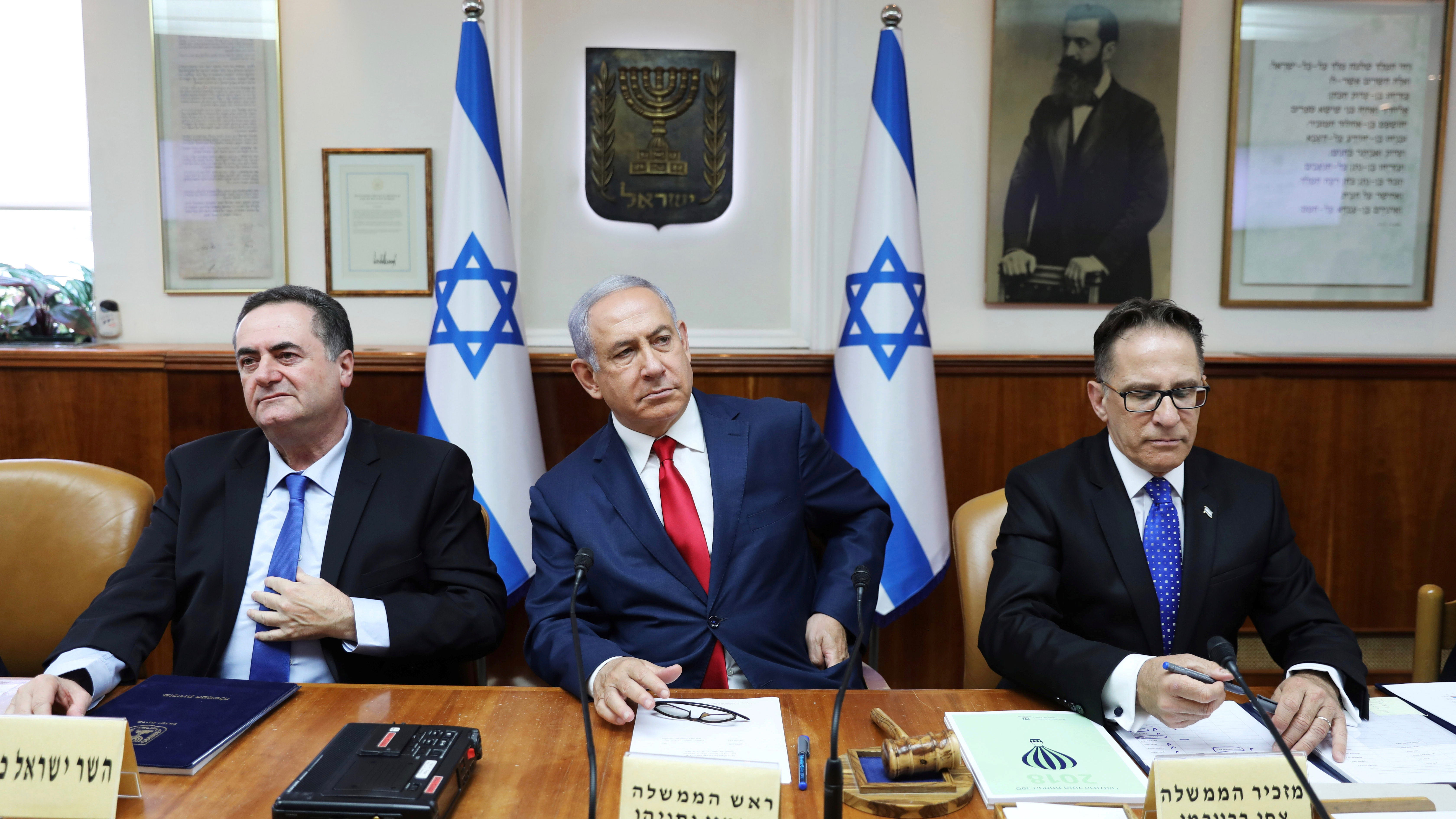 Israeli Prime Minister Benjamin Netanyahu (center), Cabinet Secretary Tzachi Braverman (right) and Minister of Foreign Affairs Israel Katz (left), attend the weekly cabinet meeting in Jerusalem on July 7, 2019.