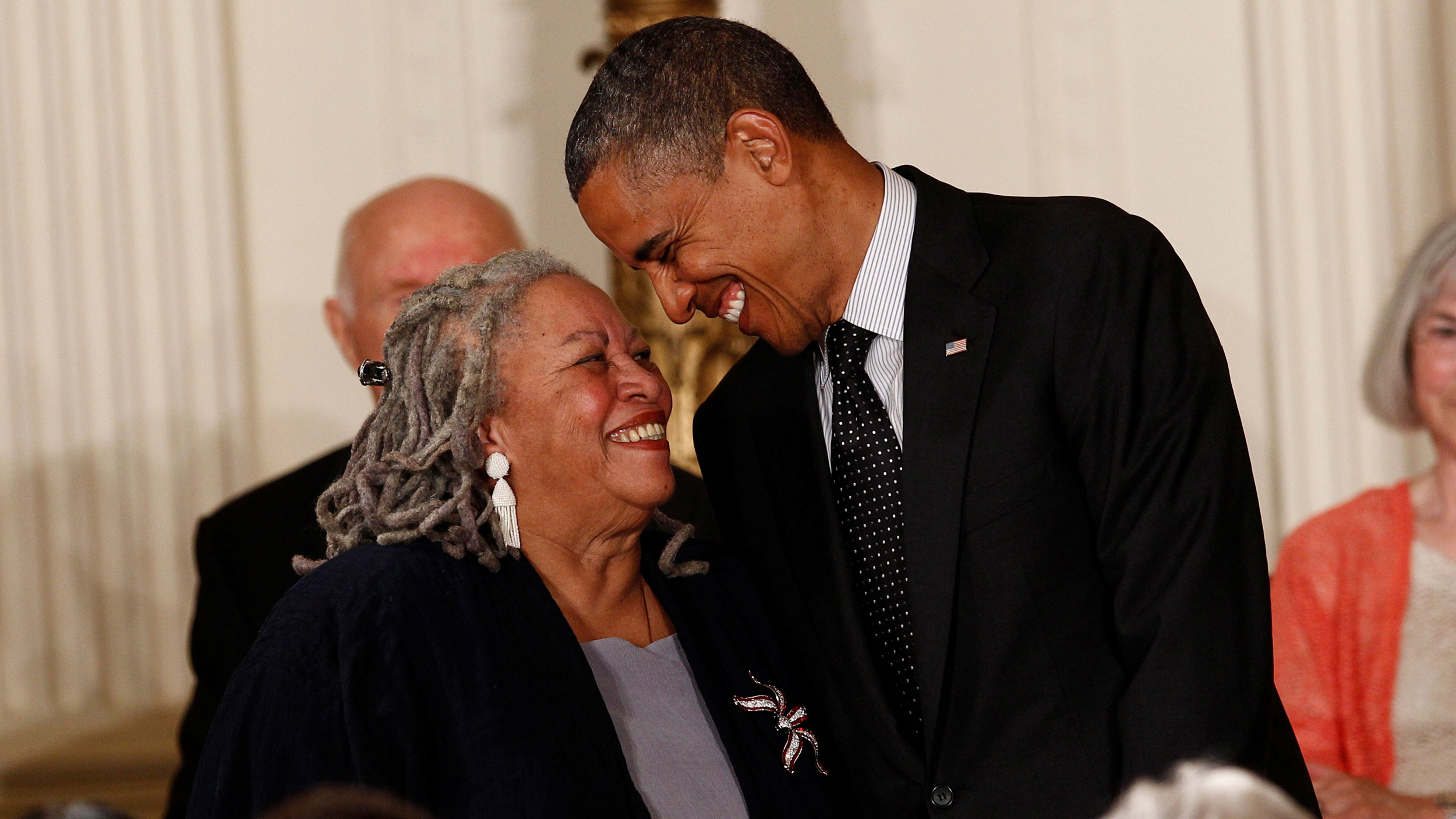 Writer Toni Morrison and Barack Obama smile at each other
