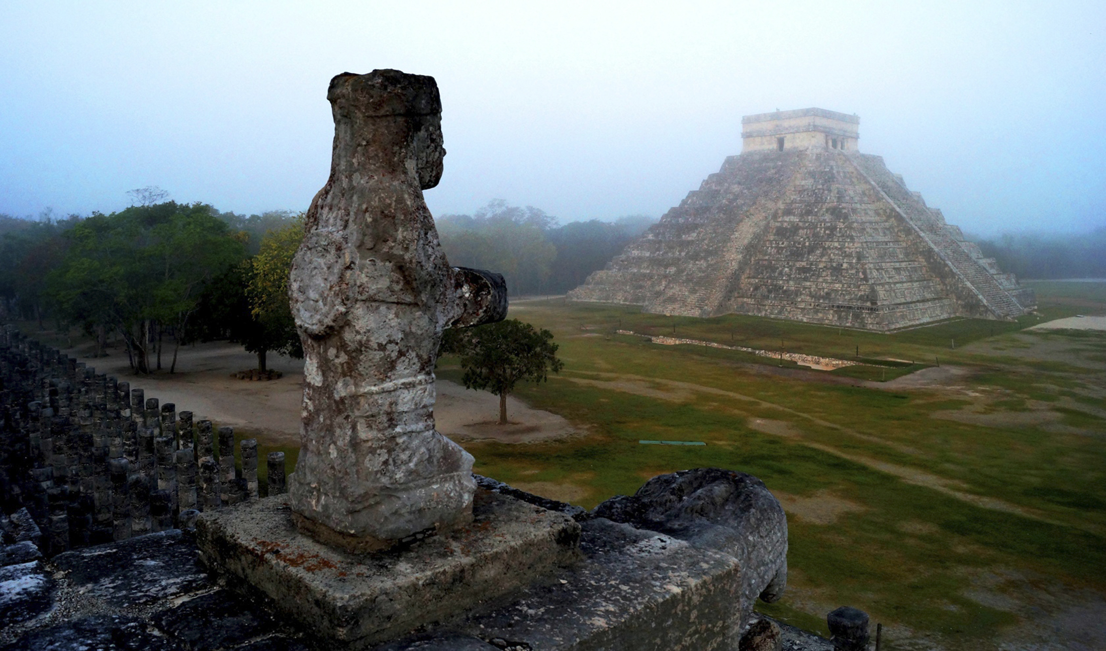 A Mayan temple is seen on a foggy morning.