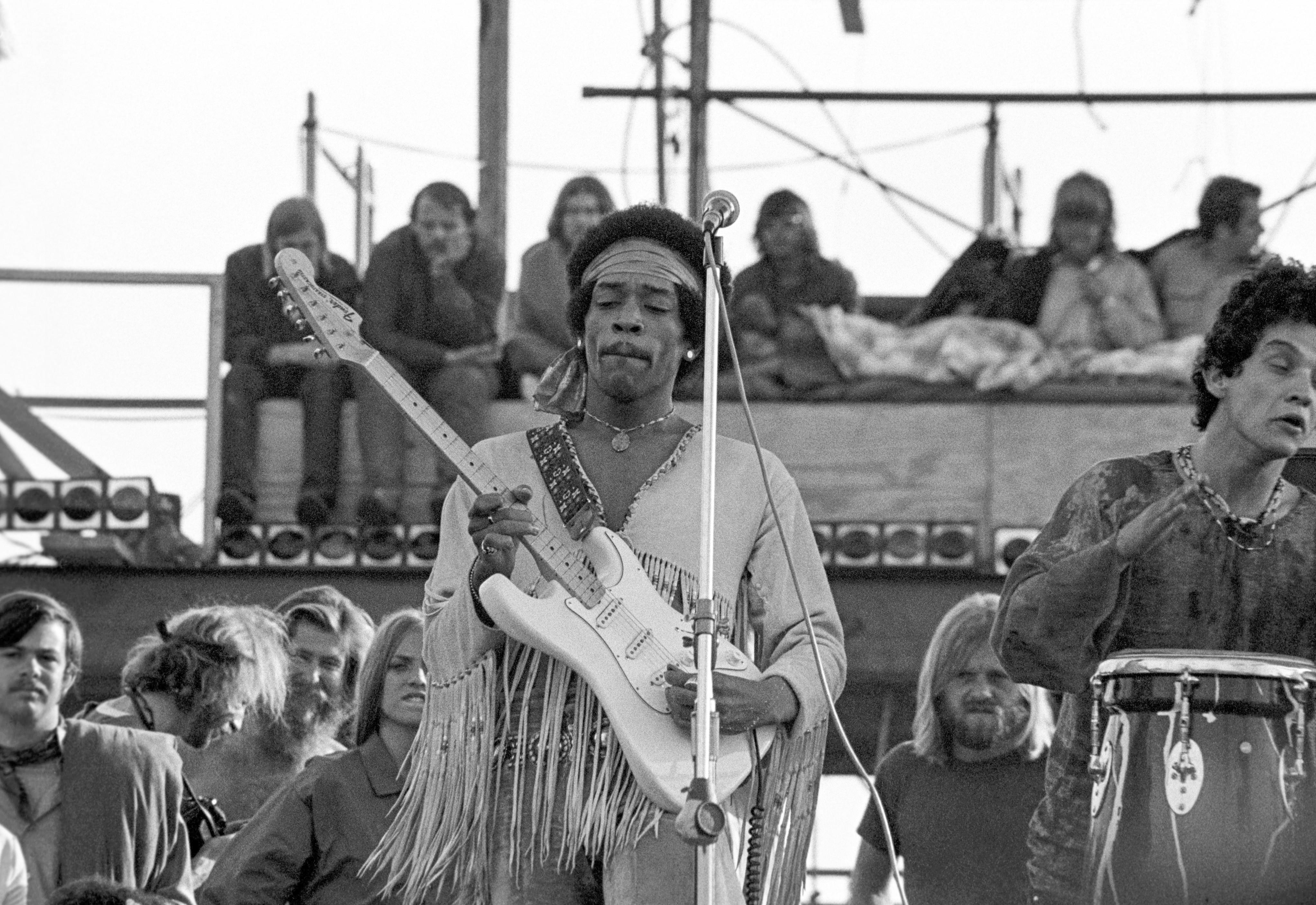 Jimi Hendrix plays at Woodstock.