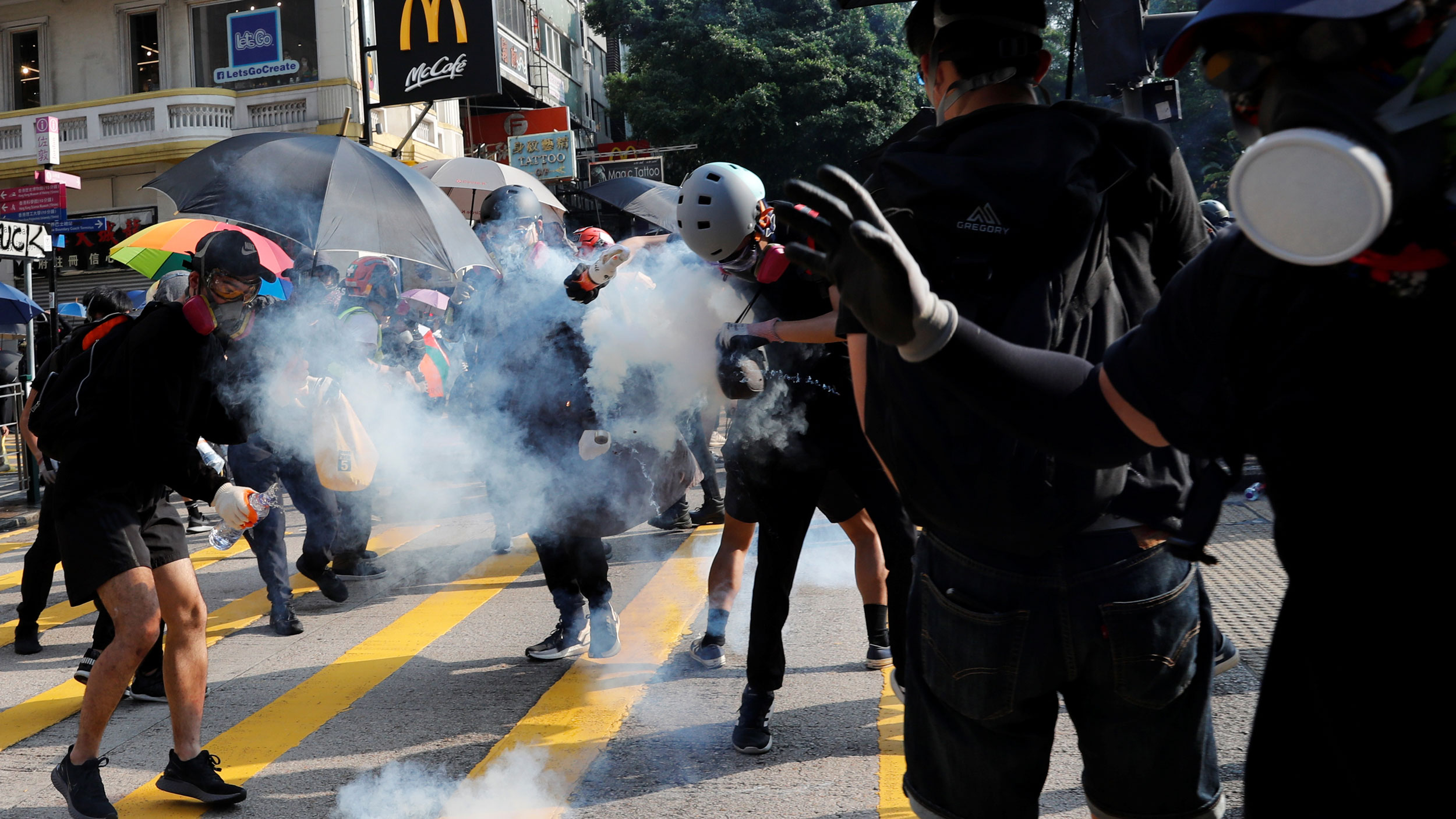 An anti-government protester hits by a tear gas canister during a protest march in Hong Kong, China, on Oct. 20, 2019.