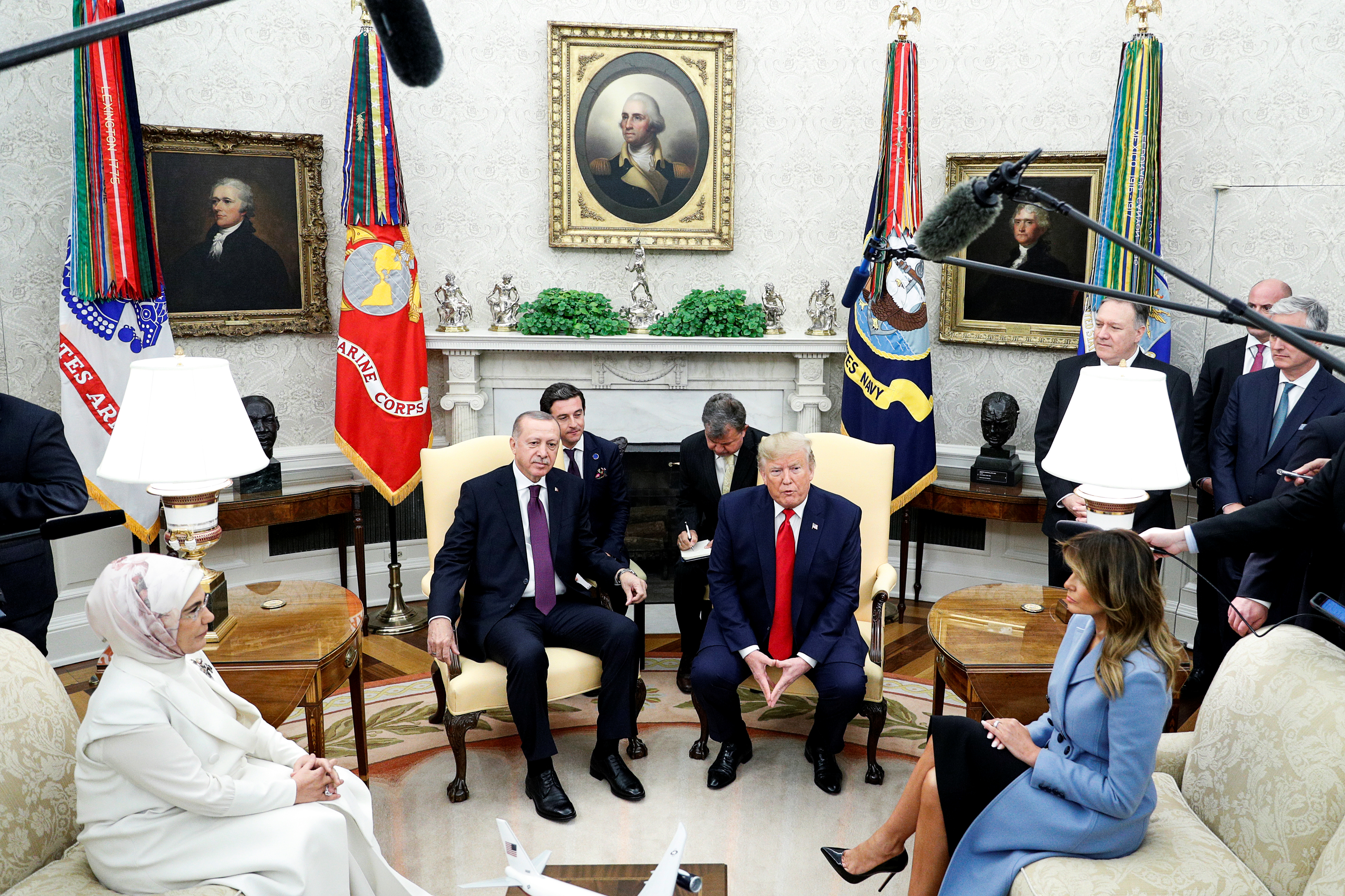 US President Donald Trump and first lady Melania Trump meet with Turkey's President Tayyip Erdogan and Emine Erdogan in the Oval Office of the White House in Washington, D.C., on November 13, 2019.