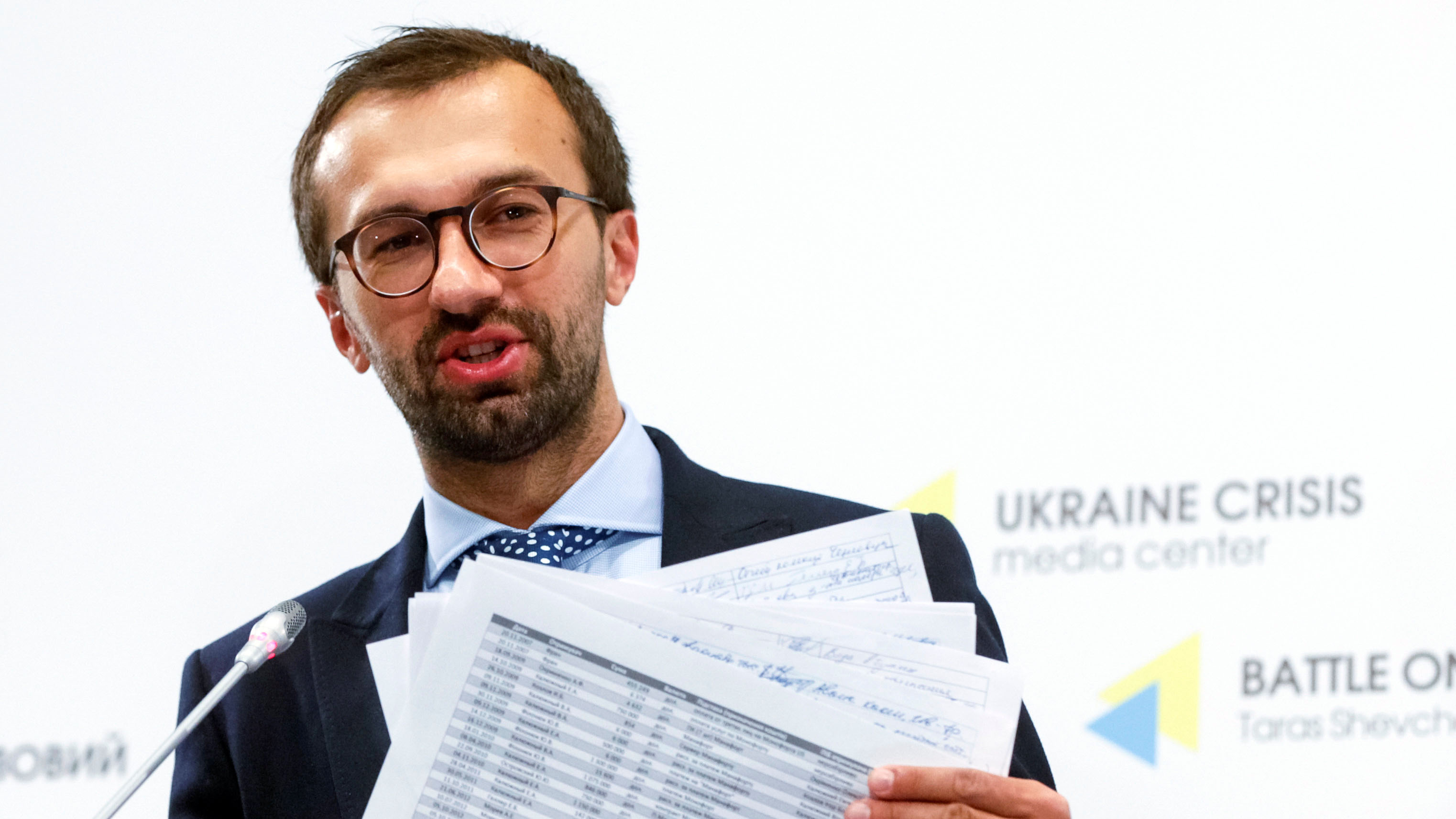 Former Ukrainian lawmaker Sergii Leshchenko displays papers from secret ledgers