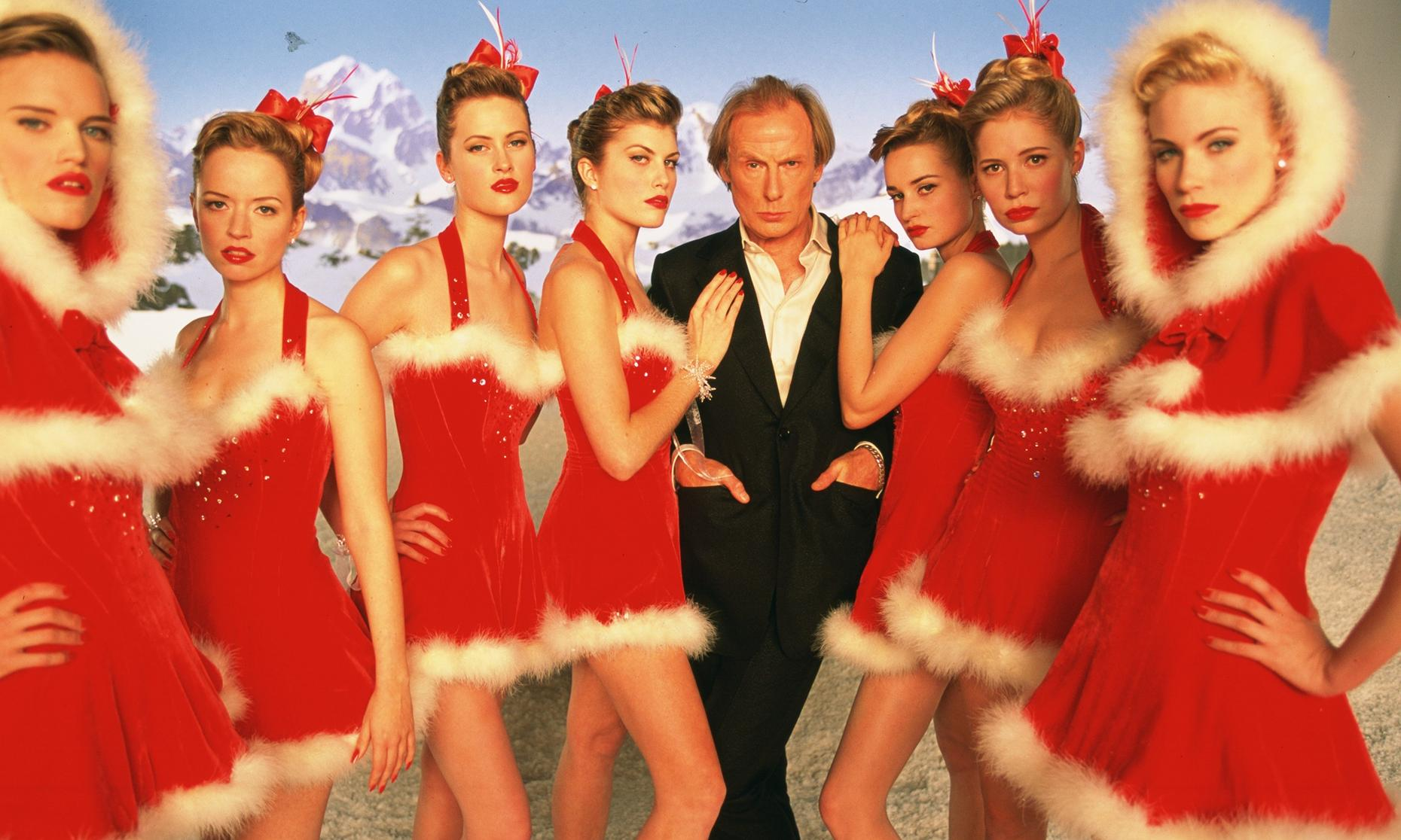 "Bill Nighy as Billy Mack with Video Vixens in ""Love Actually."""