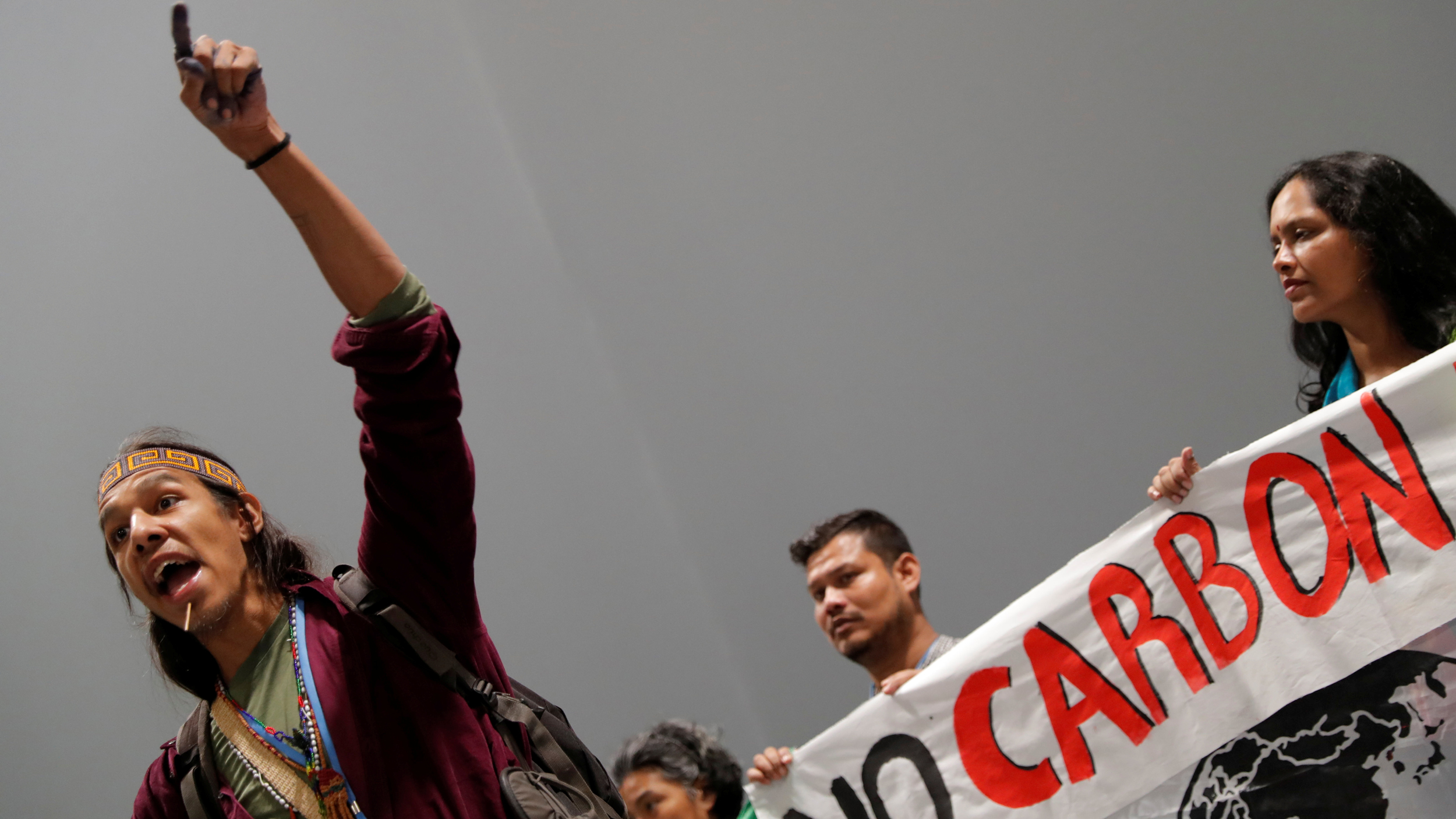 A man raises his left arm in protest.