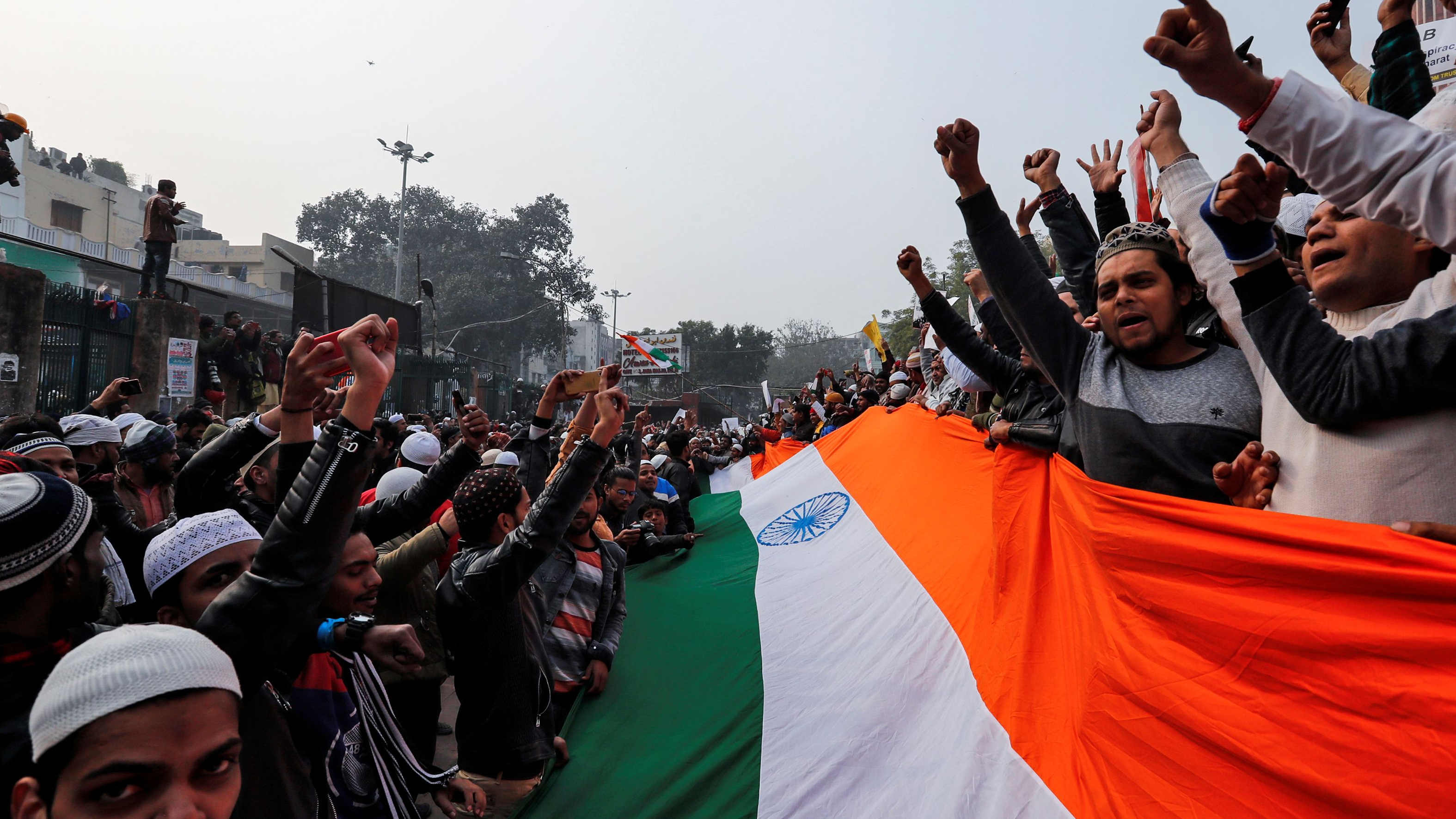Protesters hold Indian flag in Delhi