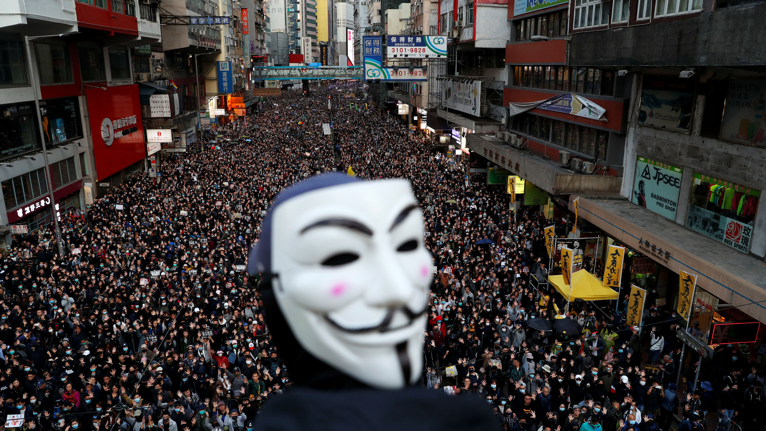 A protester wearing a Guy Fawkes mask attends a Human Rights Day march organized by the Civil Human Right Front, in Hong Kong, China, on Dec. 8, 2019.
