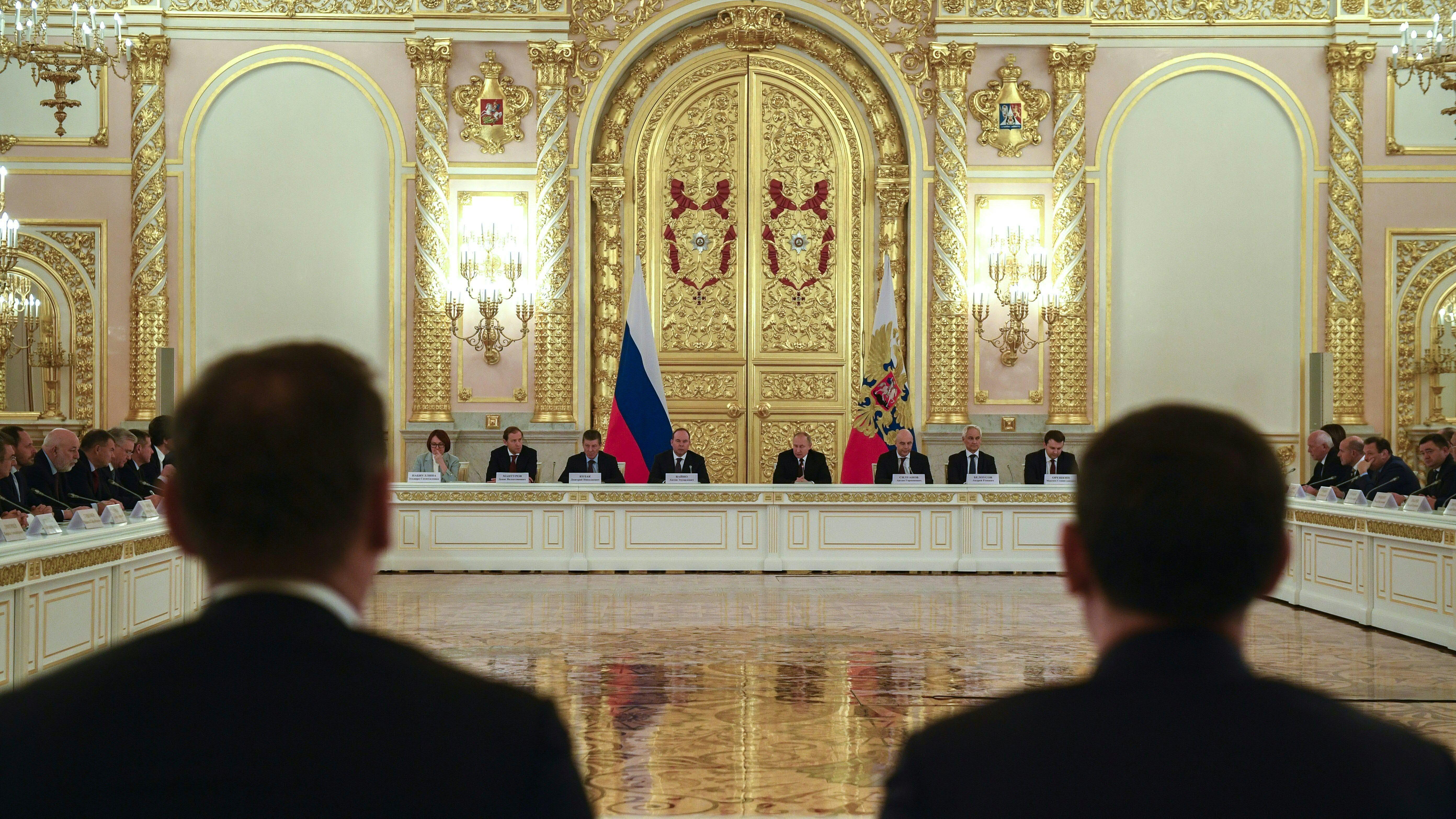 Russian President Vladimir Putin attends a meeting