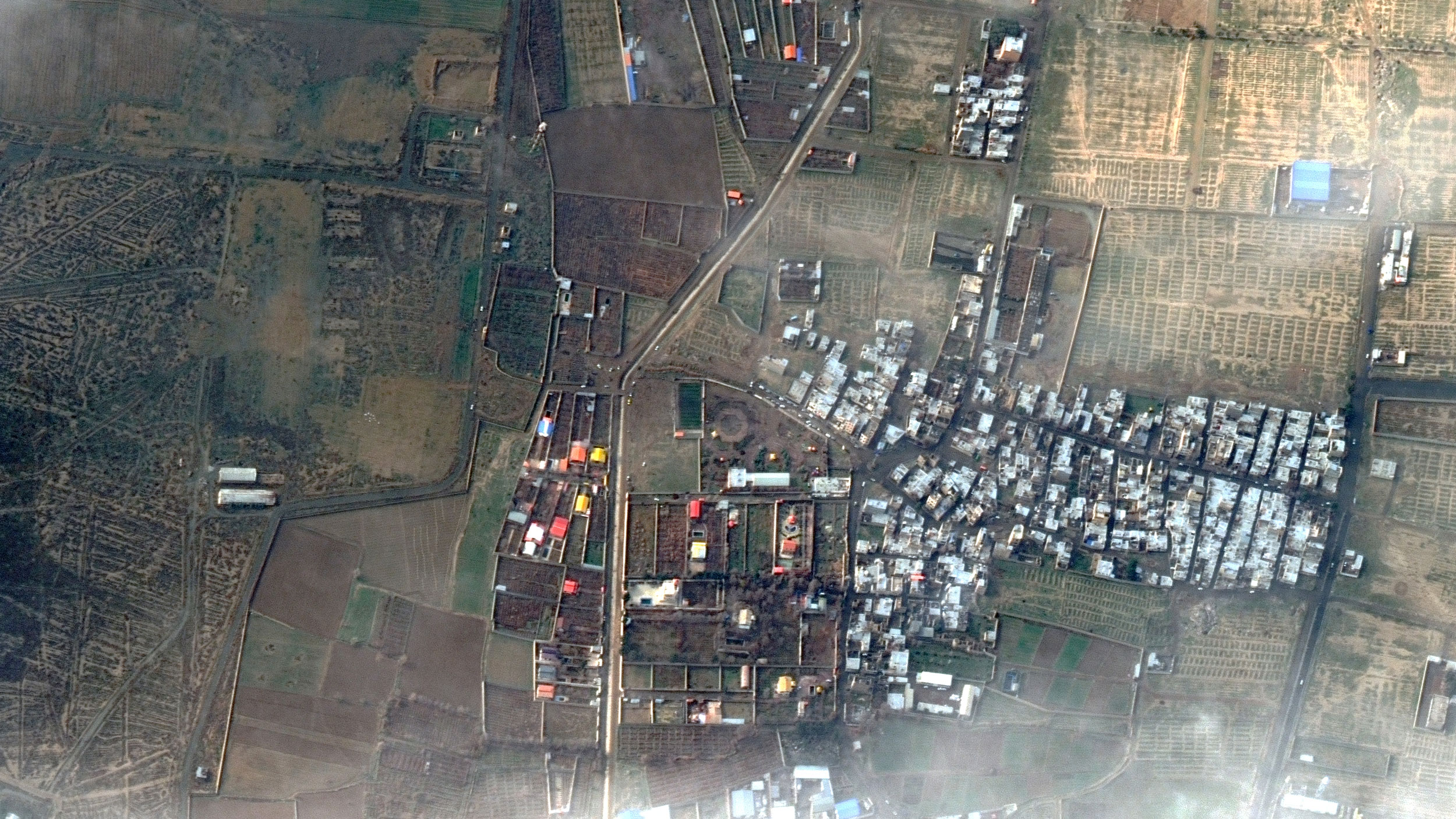 A satellite view of the area near Imam Khomeini Airport in Iran showing a cluster of buildings and the crash site.