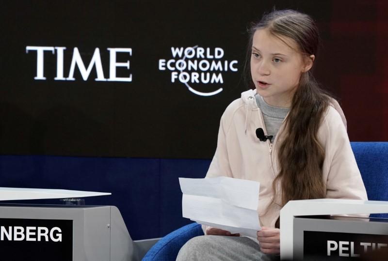 Greta Thunberg sits at the World Economic Forum.