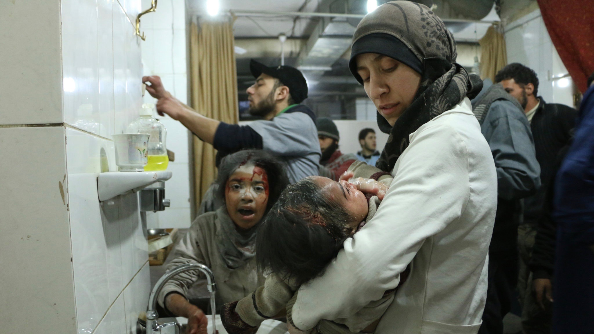 """Dr. Amani Ballour treats an injured baby in Feras Fayyad's documentary """"The Cave."""""""