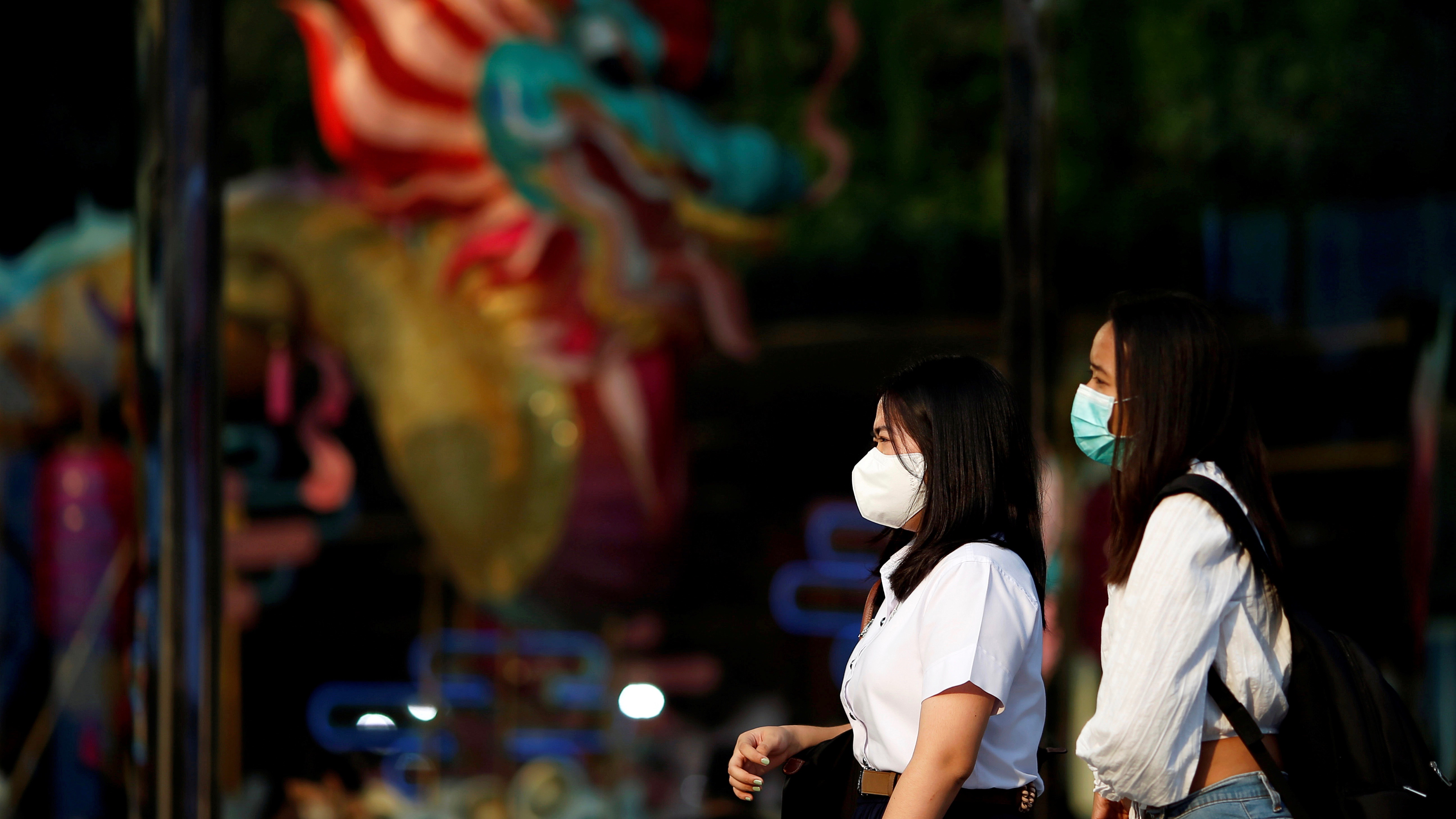 Women wear masks as a preventive measure against the coronavirus outbreak, in Bangkok, Feb. 7, 2020.