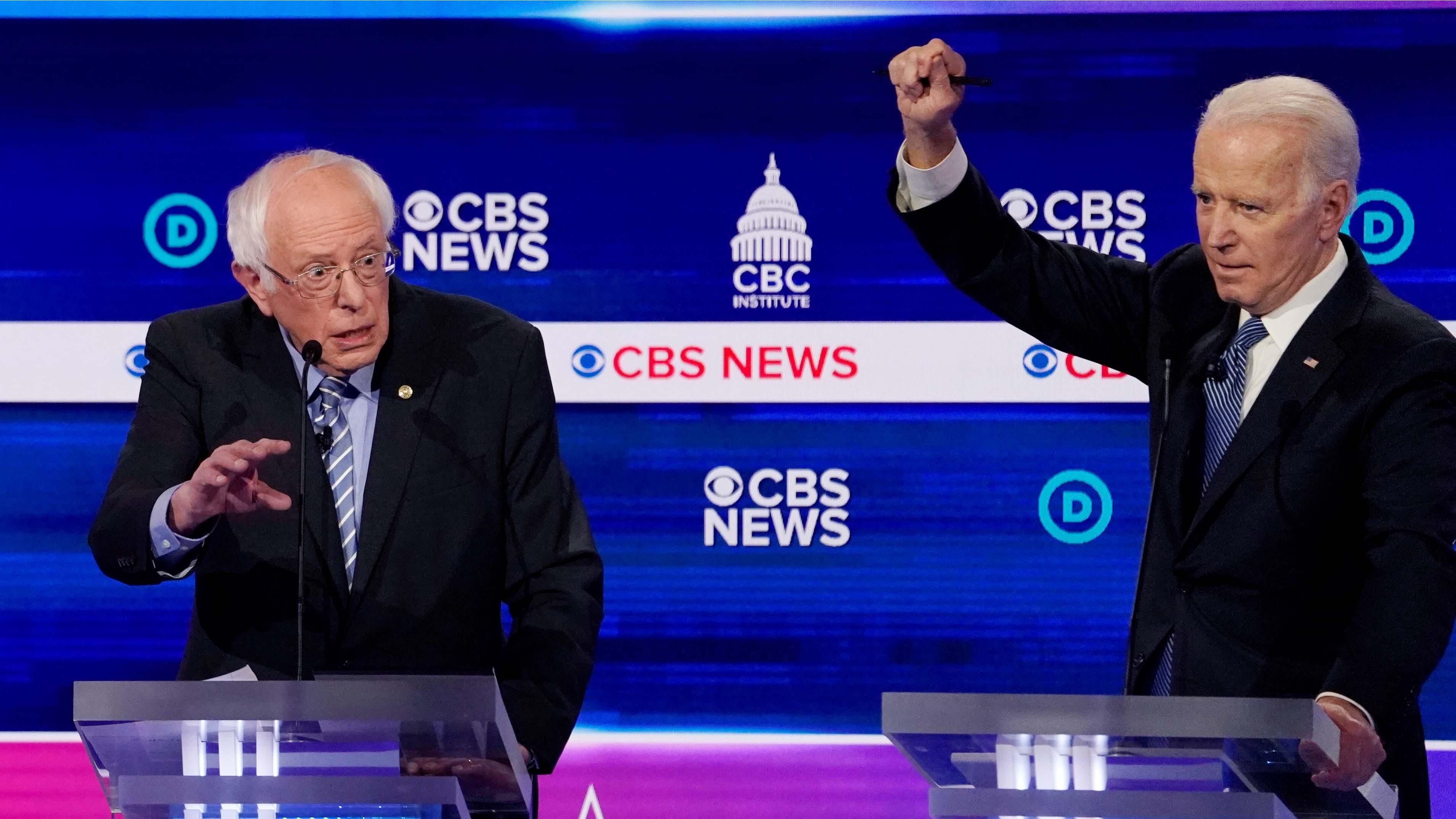 Democratic 2020 US presidential candidates Sen. Bernie Sanders and former Vice President Joe Biden participate in the tenth Democratic 2020 presidential debate at the Gaillard Center in Charleston, South Carolina, Feb. 25, 2020.
