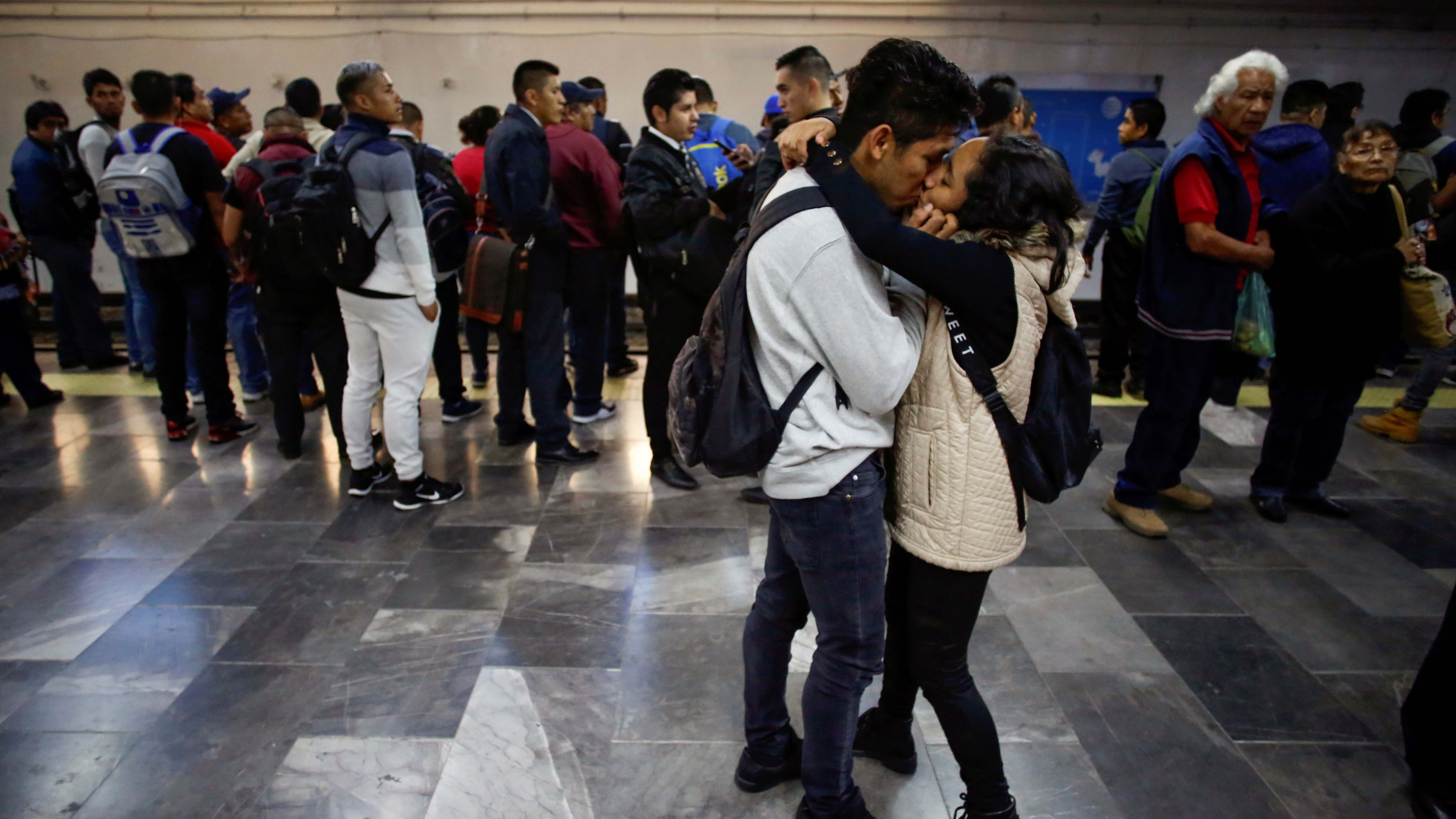 A couple kiss in the Pantitlan metro station as Mexico's government is seeking to minimize public disruption in its response to the coronavirus disease (COVID-19), in Mexico City, Mexico, on March 17, 2020.