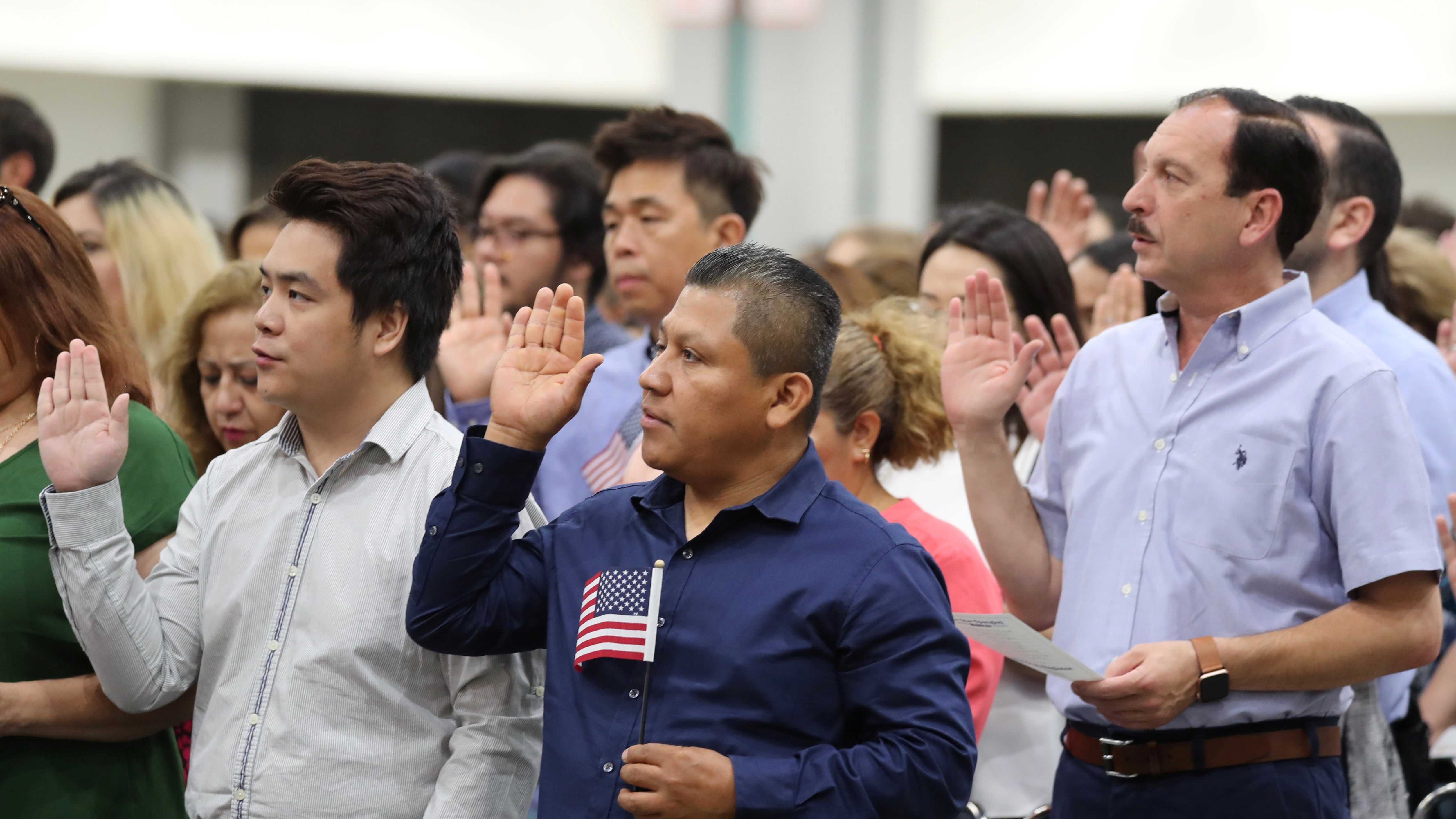 Immigrants are sworn in as new UScitizensat a naturalization ceremony in Los Angeles, Aug.22, 2019.