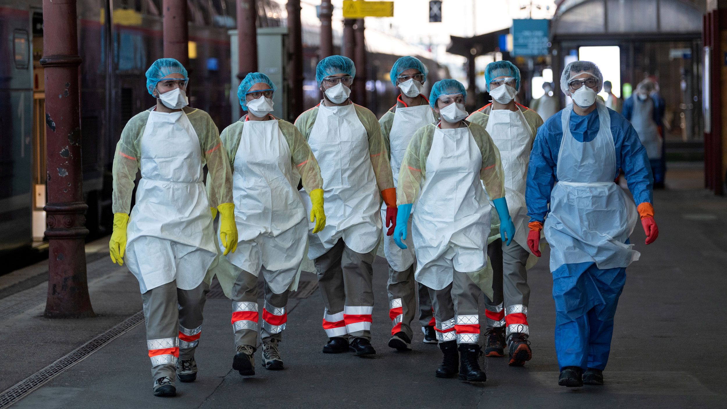 A group of people in PPE