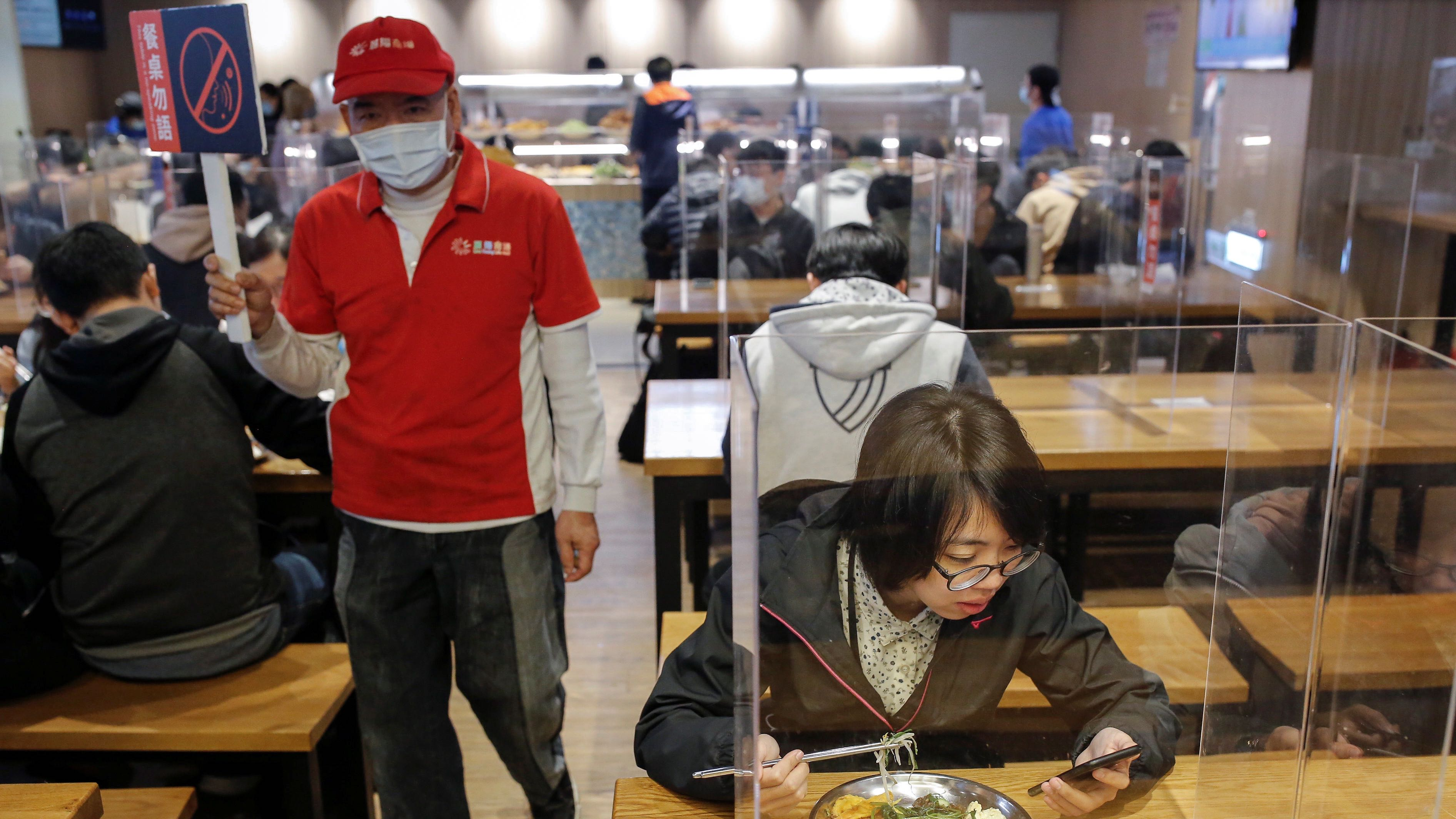 Students eat lunch between dividers to protect them from the coronavirus disease (COVID-19) in the canteen of the NationalTaiwanUniversity of Science and Technology (NTUST) in Taipei,Taiwan, April 6, 2020.