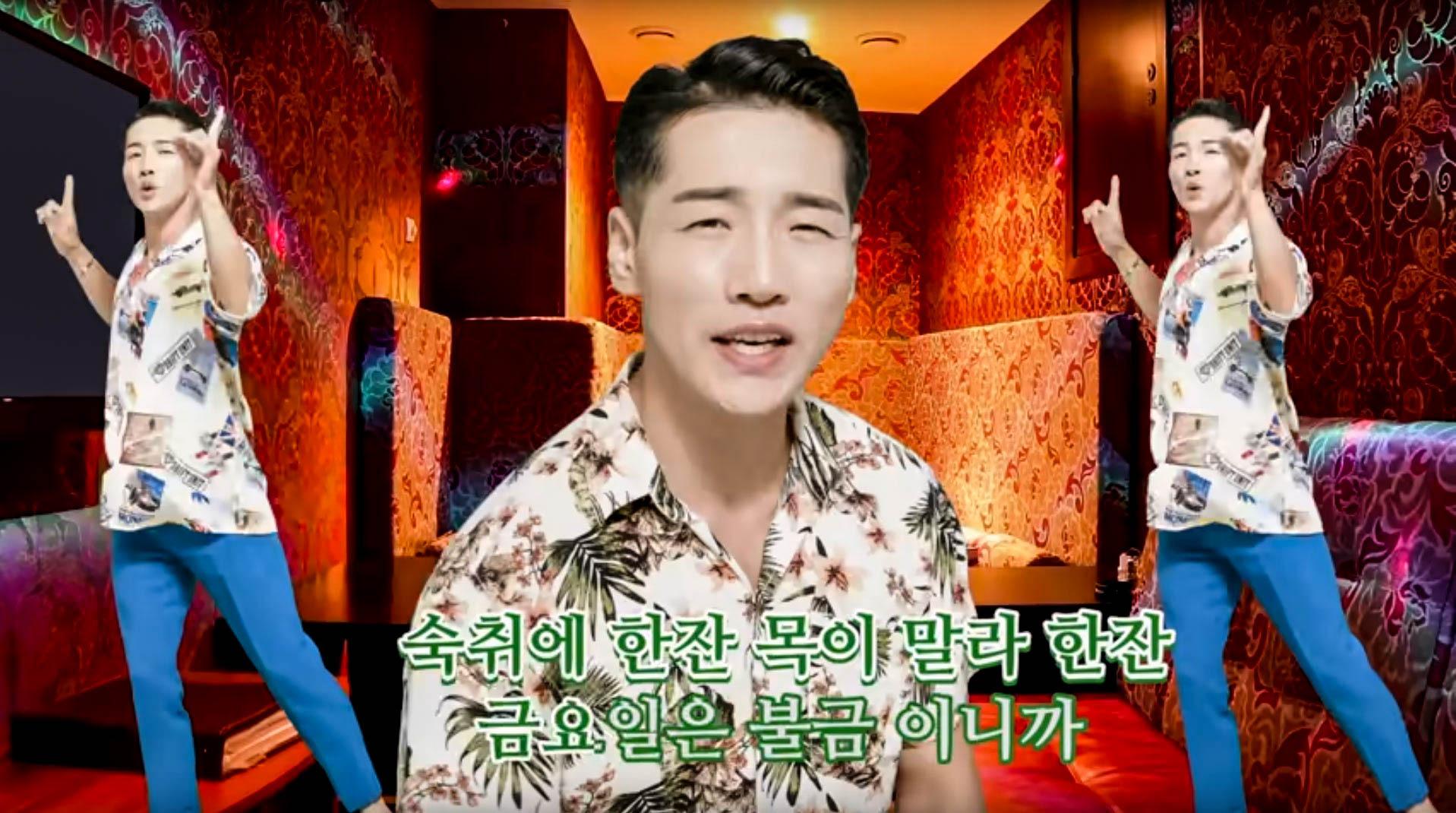 An image of a Korean music star wearing a yellow shirt