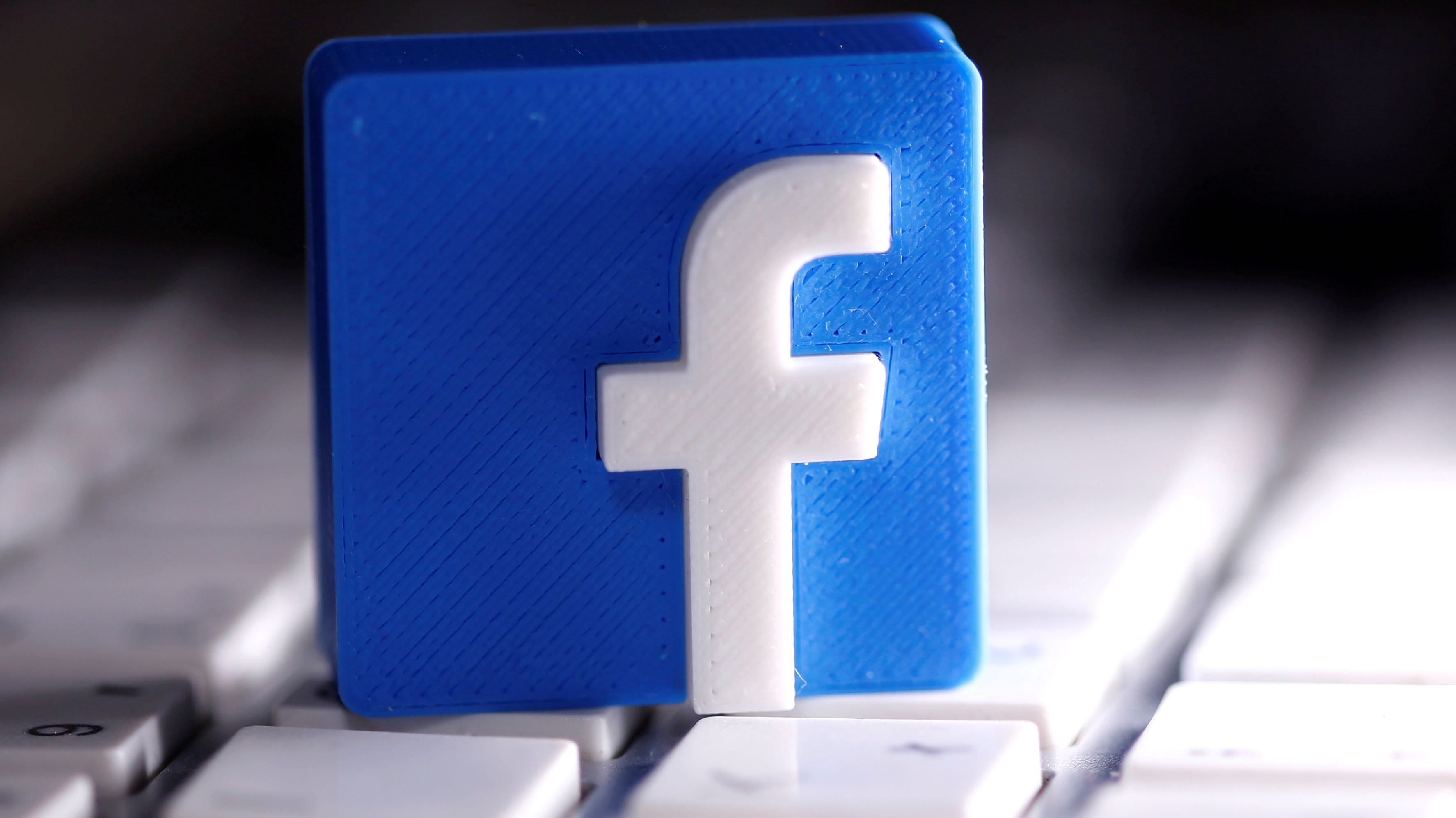 A 3D-printedFacebooklogo is seen placed on a keyboard in this illustration taken March 25, 2020.