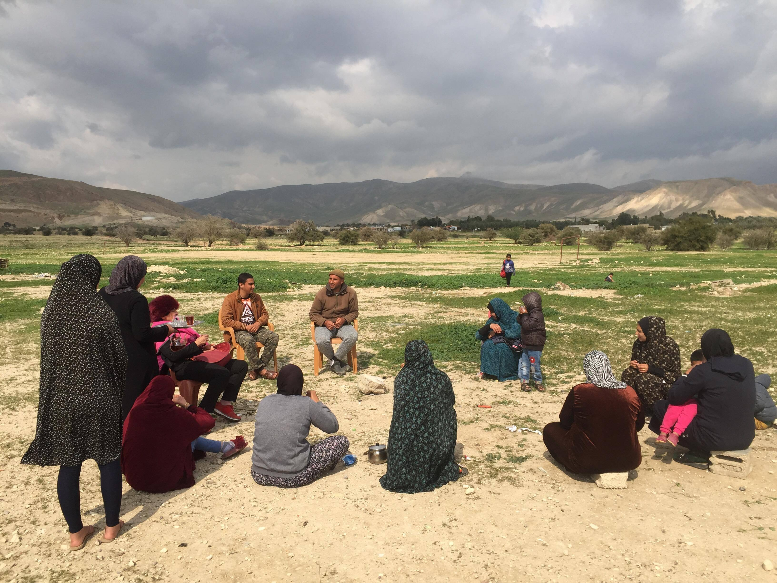 Palestinian residents of the village of Fasayil in the Jordan Valley sit together for an afternoon tea break.