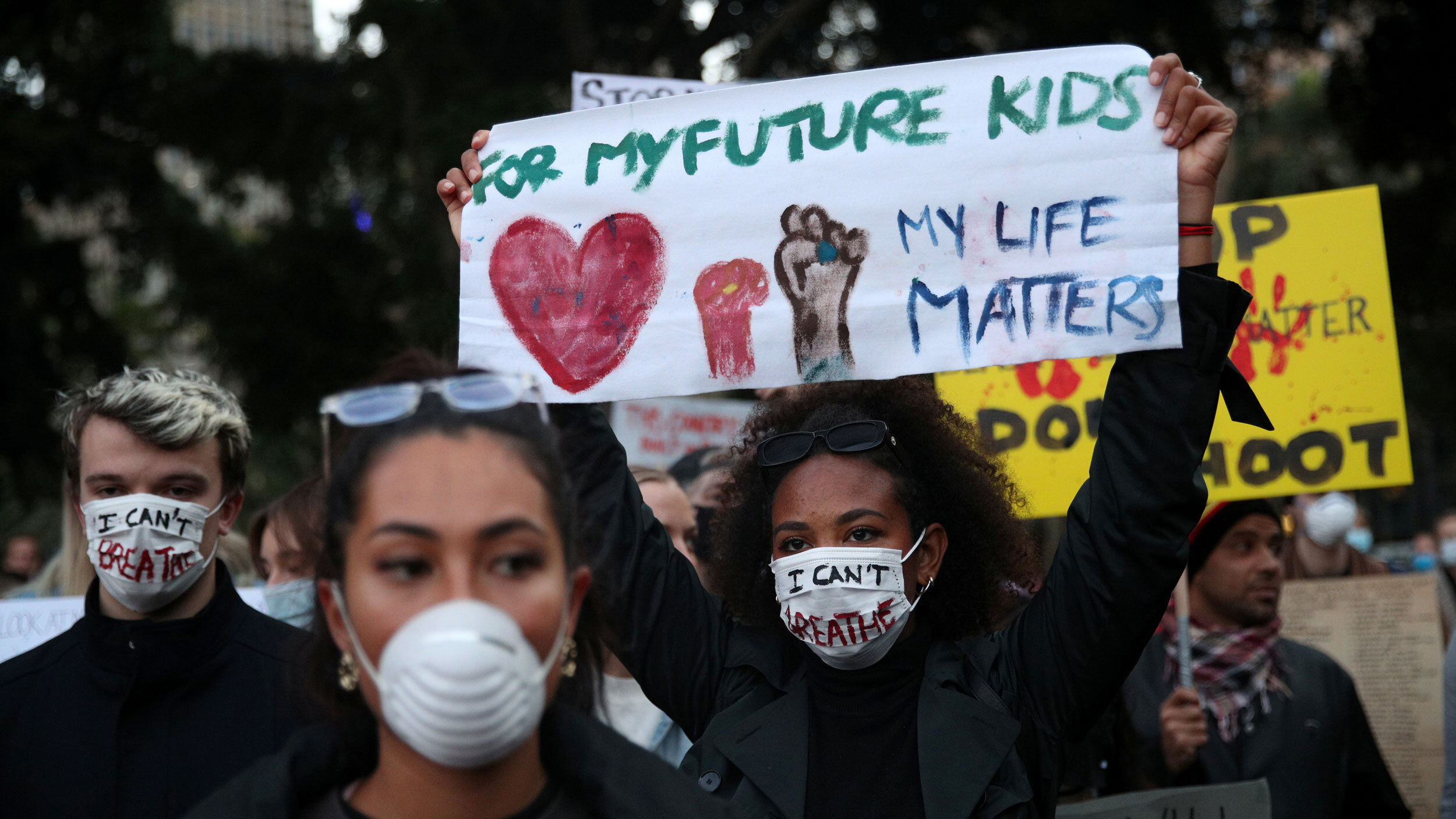 """People protest, one woman with a sign """"for my future kids my life matters"""""""