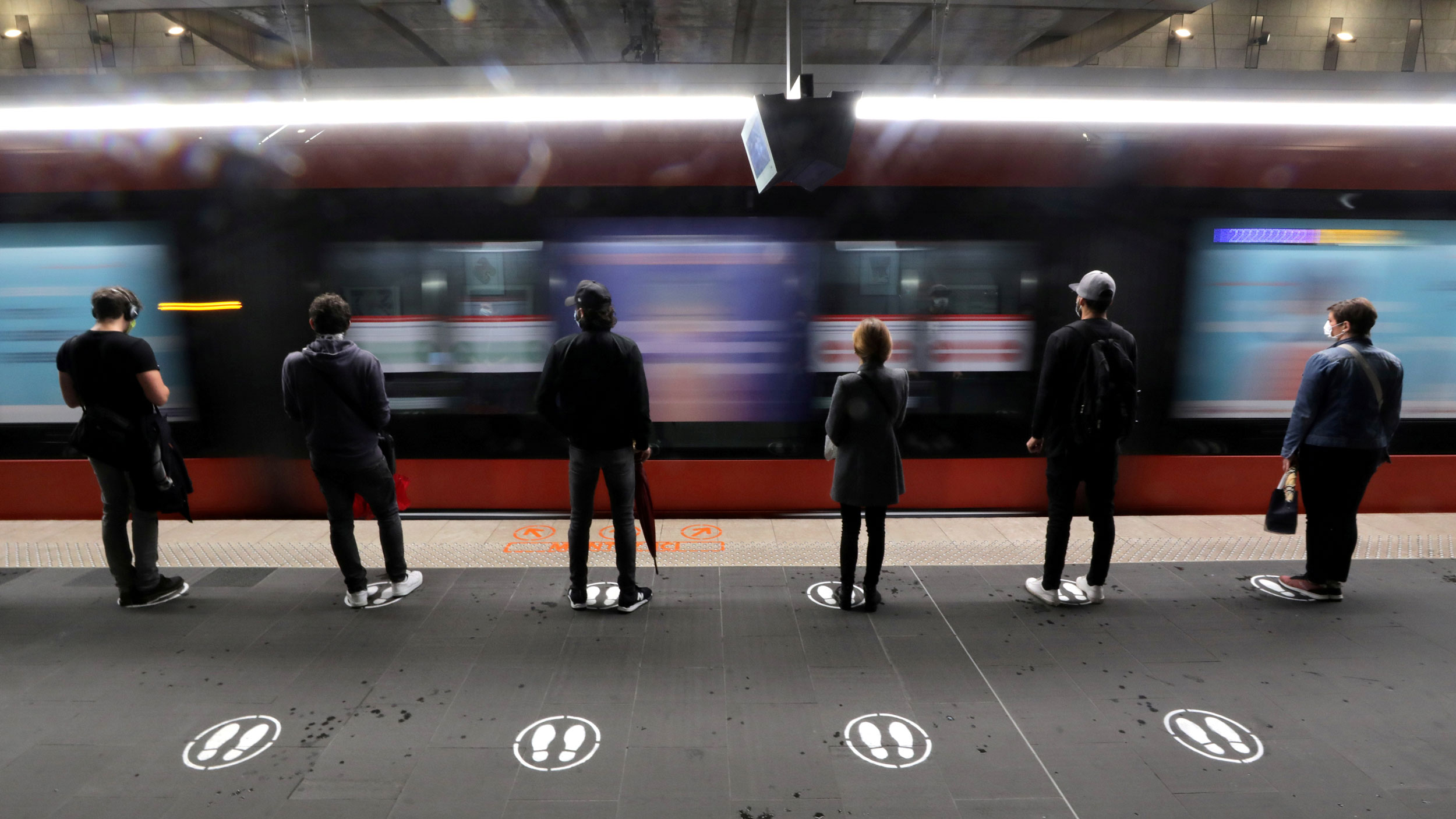 People Stand On Signs To Respect Social Distancing On A Platform For The Tramway In Nice As France Begun A Gradual End To A Nationwide Lockdown Due To The Coronavirus May 11