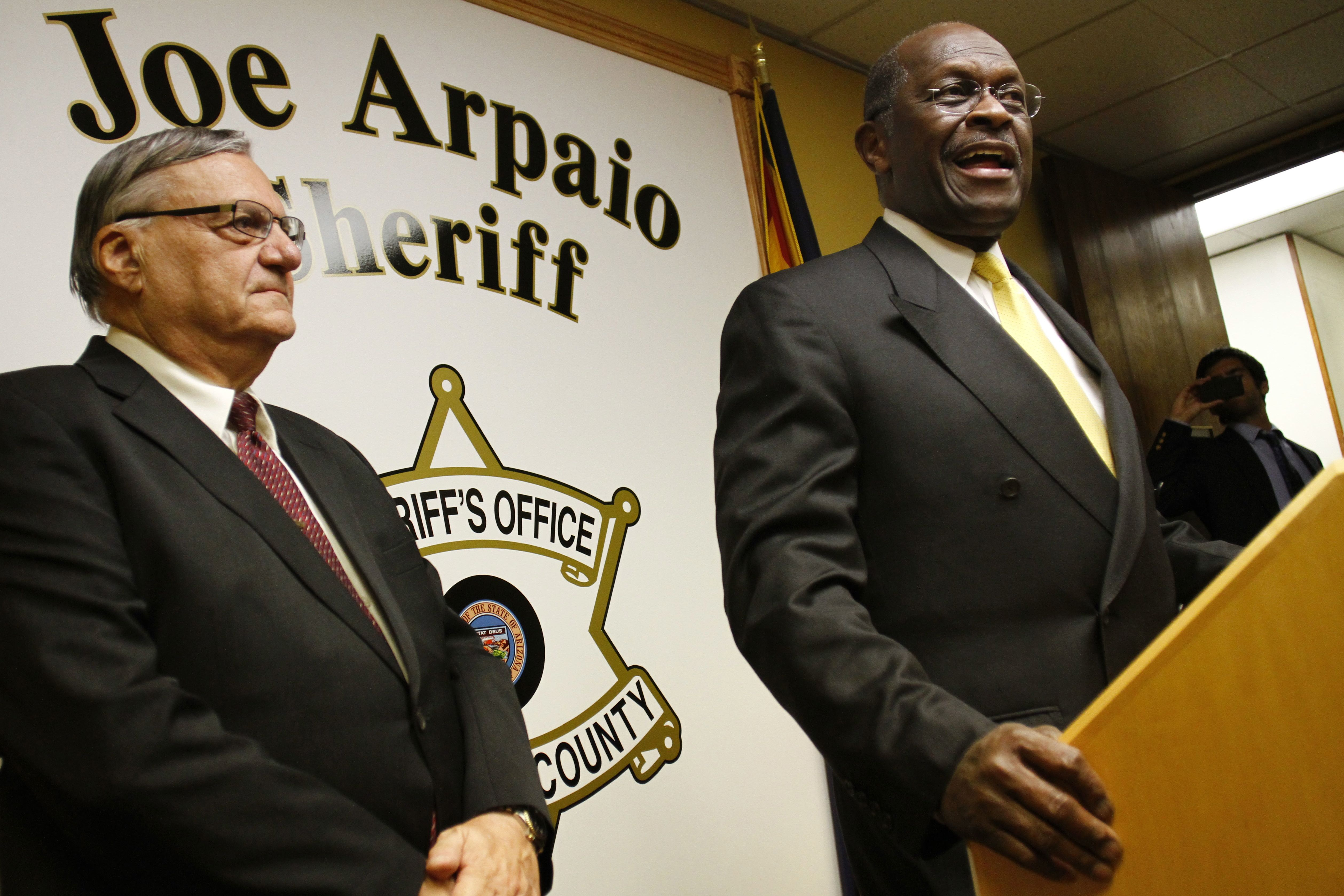 Obama birth certificate is a forgery arizona sheriff claims republican presidential candidate herman cain r speaks during a news conference with maricopa county sheriff joe arpaio at arpaios headquarters october xflitez Gallery
