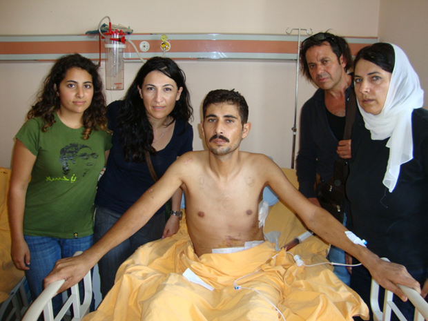 Mohja Kahf (right), her daughter, friend and brother-in-law, visiting a wounded Syrian man in Turkey.