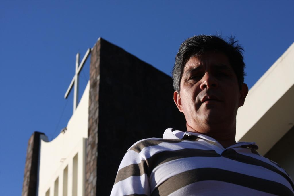 Javier Miranda in front of Ciudad del Este's main cathedral.