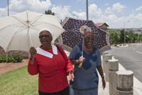 Soweto women walk up historic Vilakazi Street.