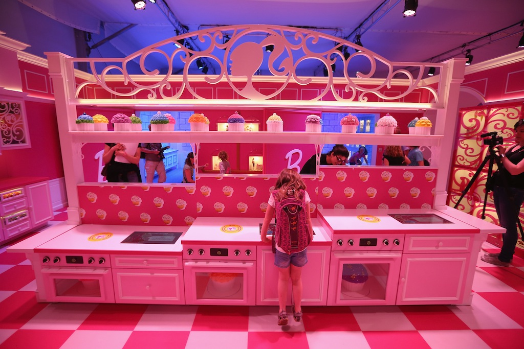 a young visitor inspects the kitchen at the barbie dreamhouse experience on may 16 in berlin germany the barbie dreamhouse is a lifesized house