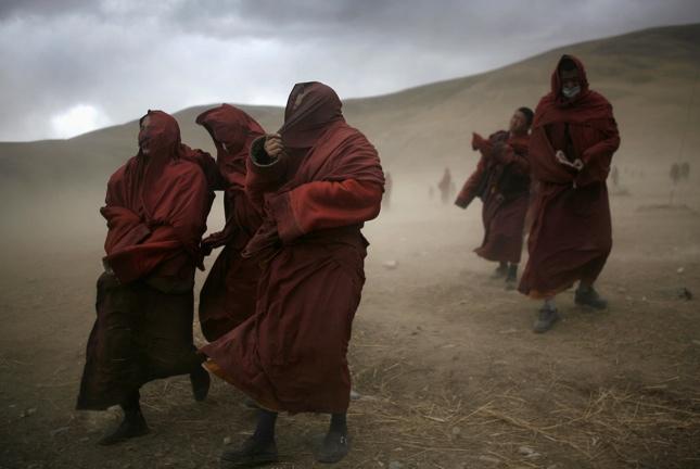 Tibet monks, sandstorm, earthquake