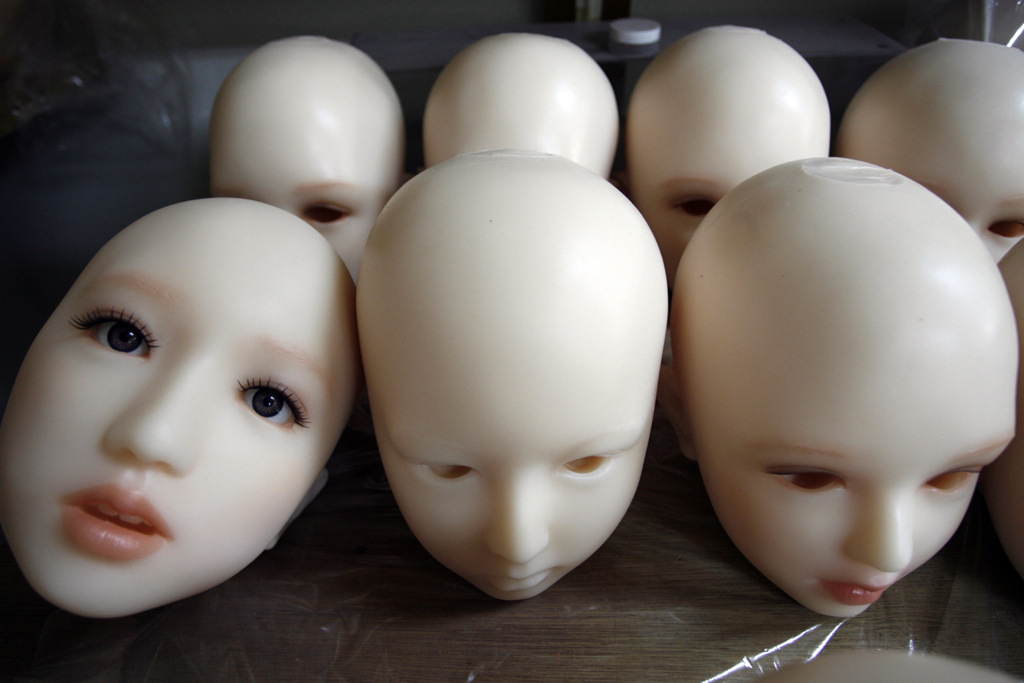 Unfinished sex doll heads are pictured at Orient Industry