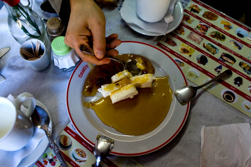 Plate of kaymak and honey and glass of warm milk at Karakoy Ozsut.
